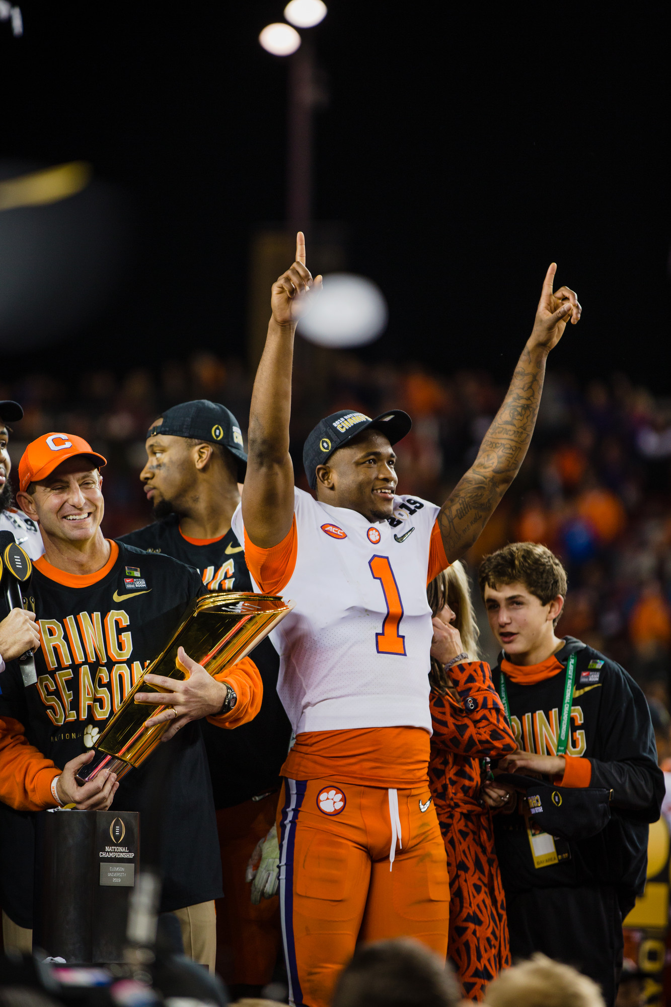 Clemson head coach Dabo Swinney holds the 2019 CFP National Championship trophy as cornerback Trayvon Mullen, the game's defensive MVP, celebrates at Levi's Stadium in Santa Clara, California, on Monday, Jan. 7 after the Tigers routed Alabama 44-16.