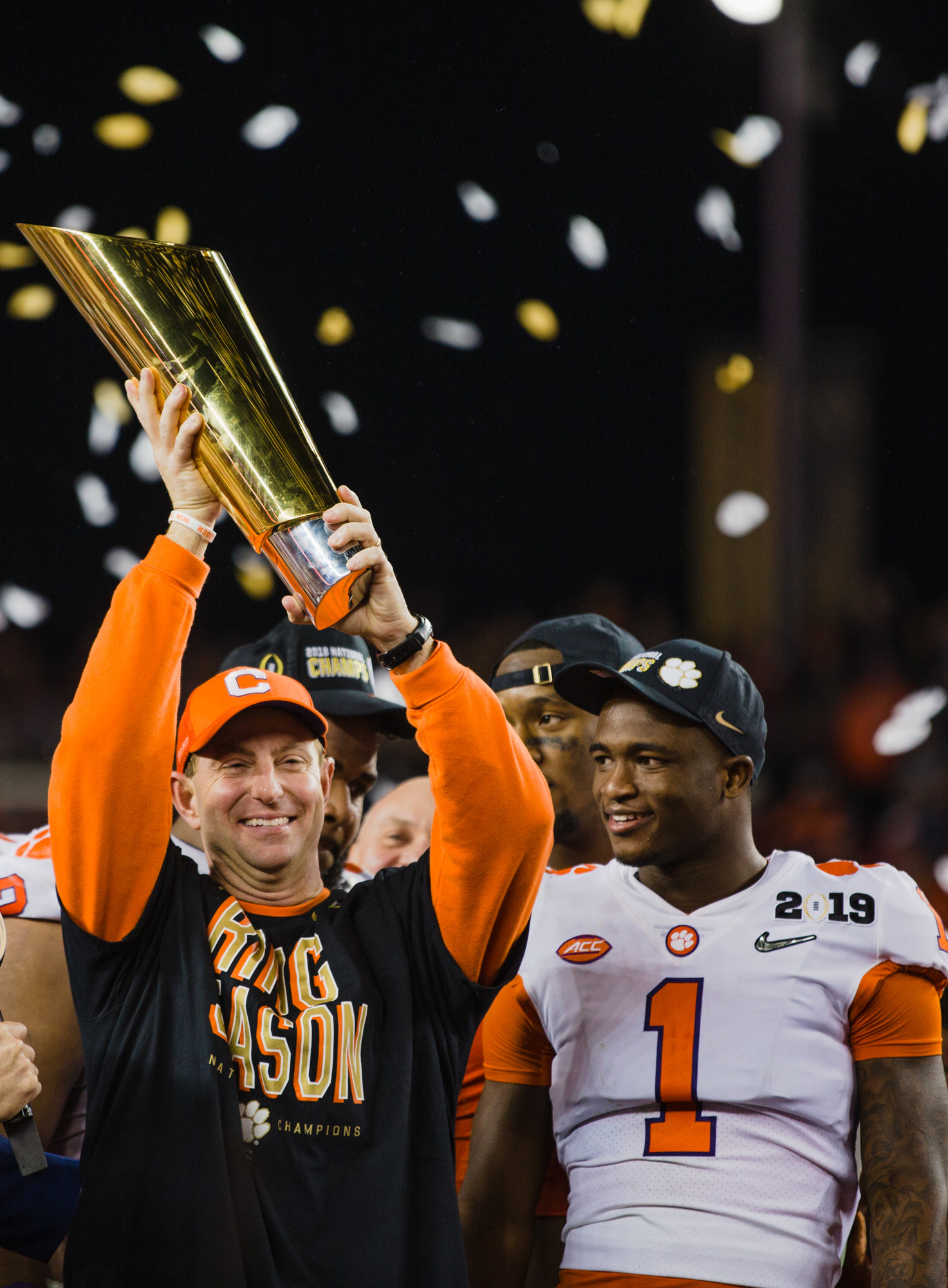 Clemson head coach Dabo Swinney hoists the 2019 CFP National Championship trophy as cornerback Trayvon Mullen, the game's defensive MVP, looks on at Levi's Stadium in Santa Clara, California, on Monday, Jan. 7 after the Tigers routed Alabama 44-16.