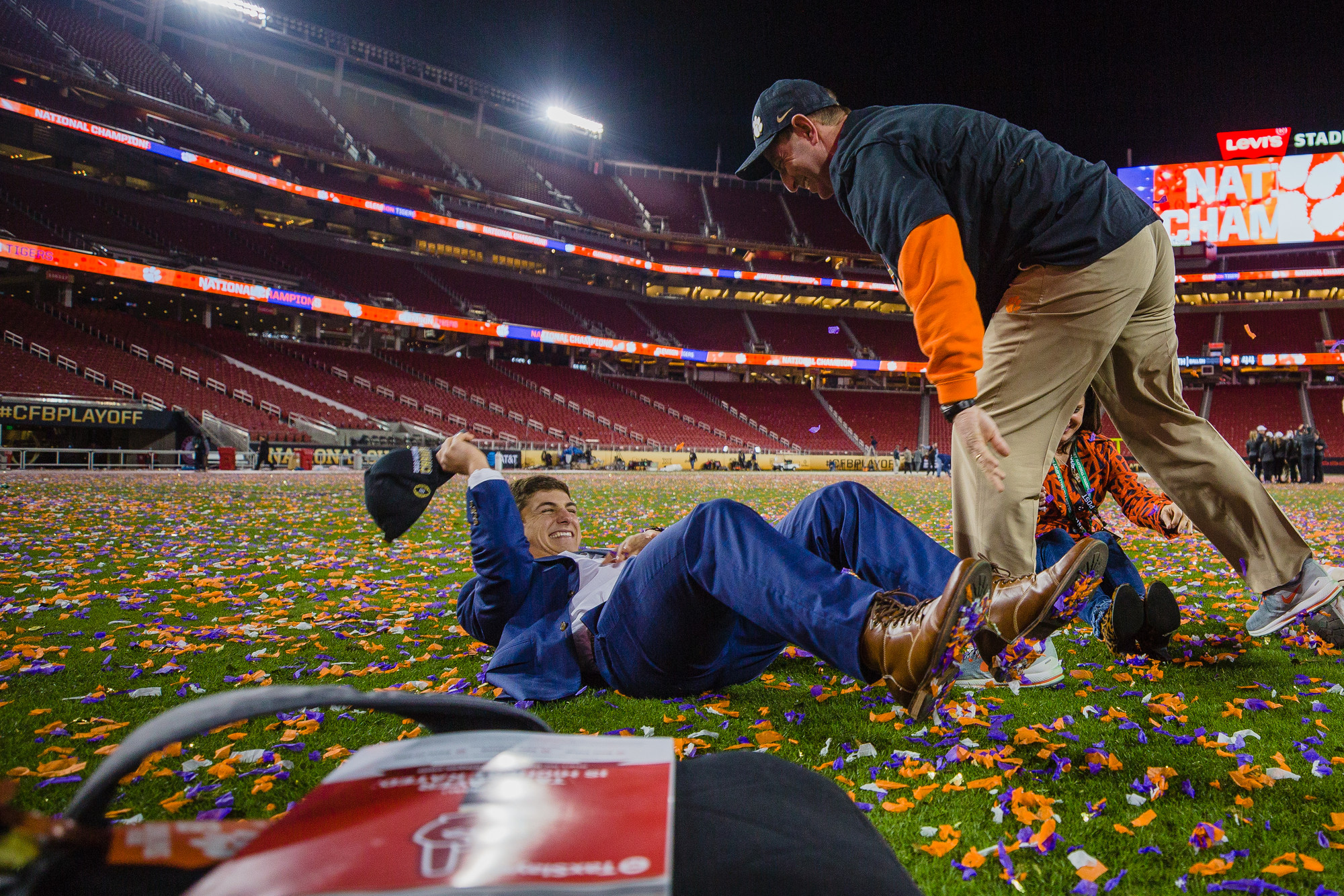 Clemson head coach Dabo Swinney finds time after everyone else left the stadium to celebrate the moment with his family after the Tigers routed Alabama 44-16 to win the CFP National Championship at Levi's Stadium in Santa Clara, California, on Monday, Jan. 7.