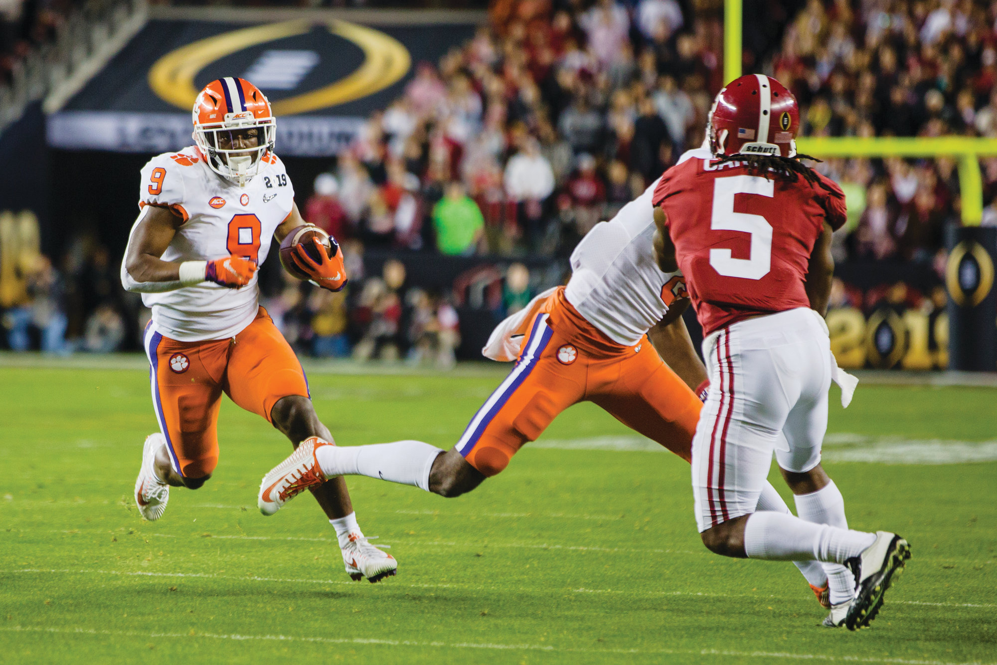 Clemson running back Travis Etienne (9) will return in 2019 to try to help the Tigers' to a fifth straight appearance in the College Football Playoff and to defend their national title. However, the Tigers may start out at No. 2 in the preseason poll behind Alabama despite handing the Crimson Tide one of their worst losses in a generation.
