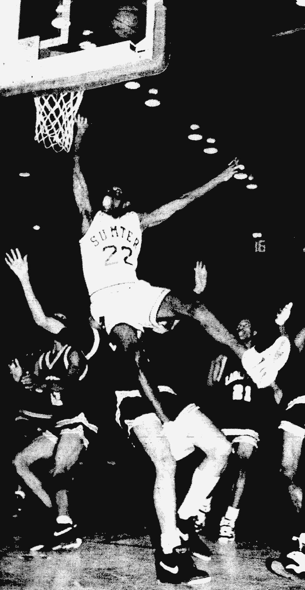 SUMTER ITEM FILE PHOTO  A Sumter High School player goes for two points during the school's game in January 1994.