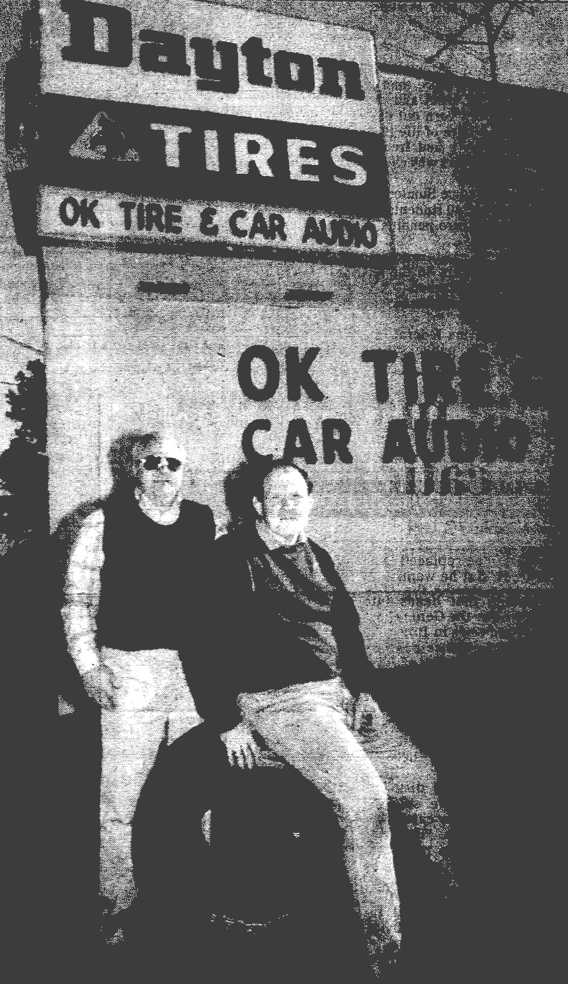 SUMTER ITEM FILE PHOTO A.D. Allbritton Jr., left, and Joe Albritton stand in front of OK Tire and Car Audio at the corner of Broad Street and Bultman Drive. The Allbrittons' father, A.D. Allbritton Sr., founded the company in 1958.