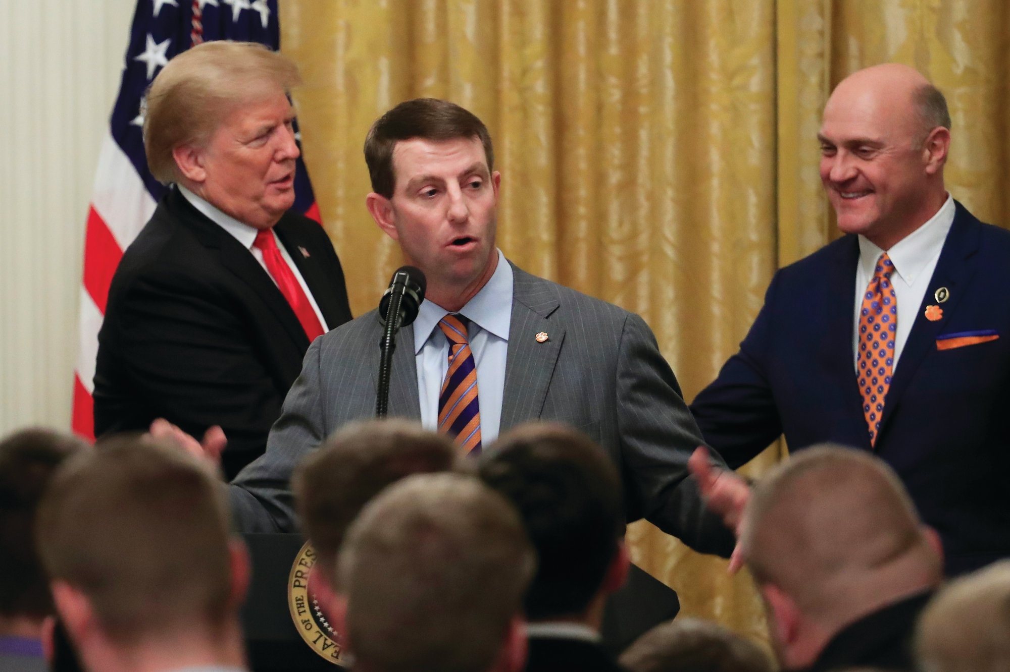 THE ASSOCIATED PRESS Clemson football head coach Dabo Swinney, center, speaks as President Donald Trump shakes hands with Clemson President James Clements during a ceremony at the White House in Washington on Monday to honor the Tigers' national championship victory.