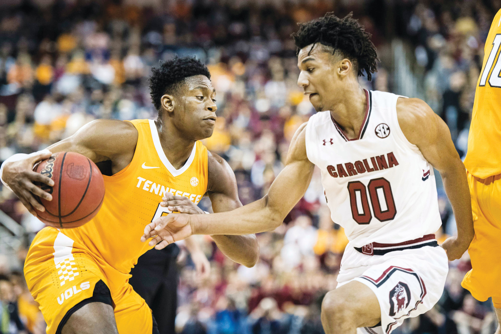 Tennessee guard Admiral Schofield, left, drives to the hoop against South Carolina guard AJ Lawson during the top-ranked Volunteers' 92-70 win on Tuesday in Columbia.