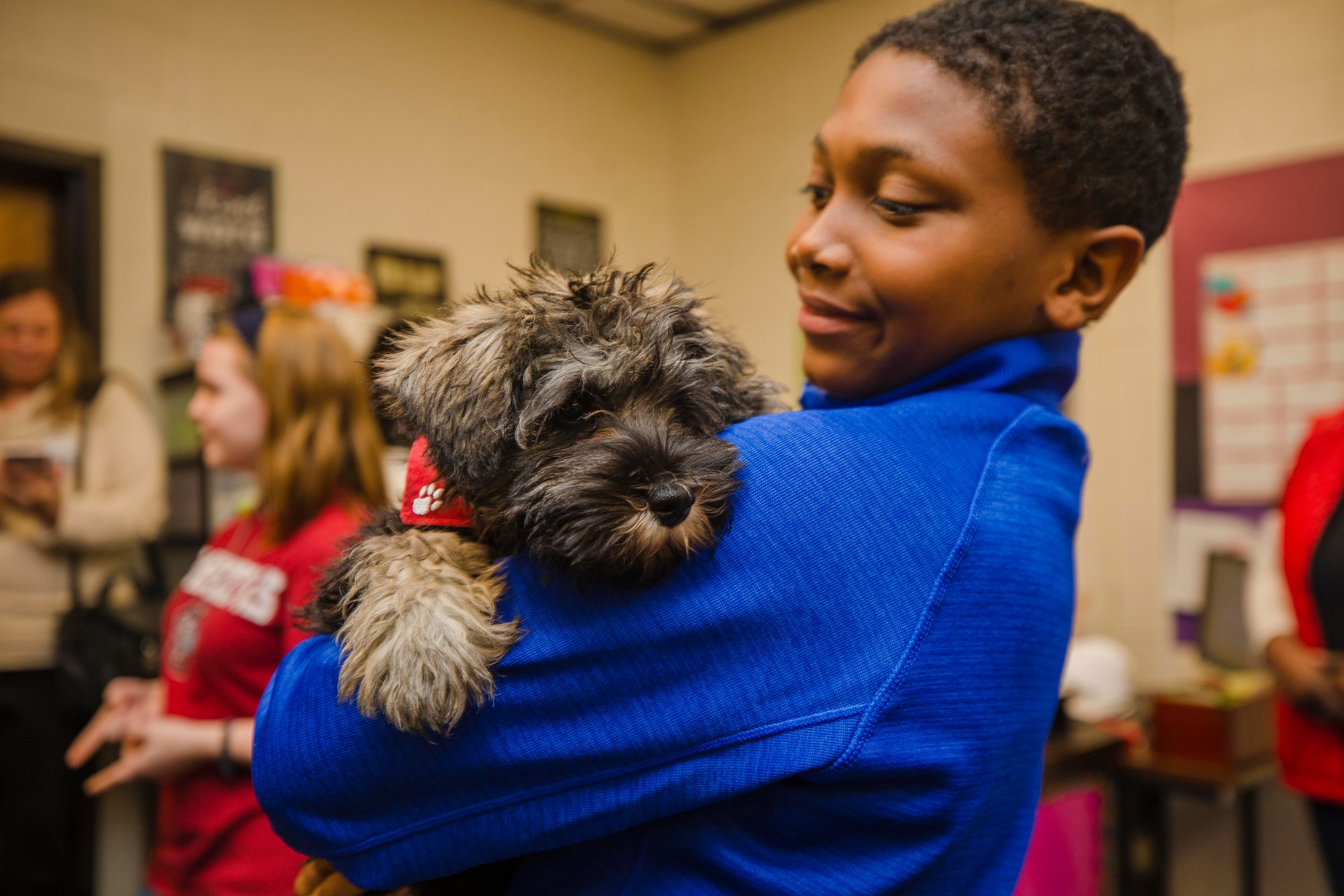 Bantam rests on the shoulder of Samuel Laws, a student in Lisa Sanders's class at Bates Middle School.