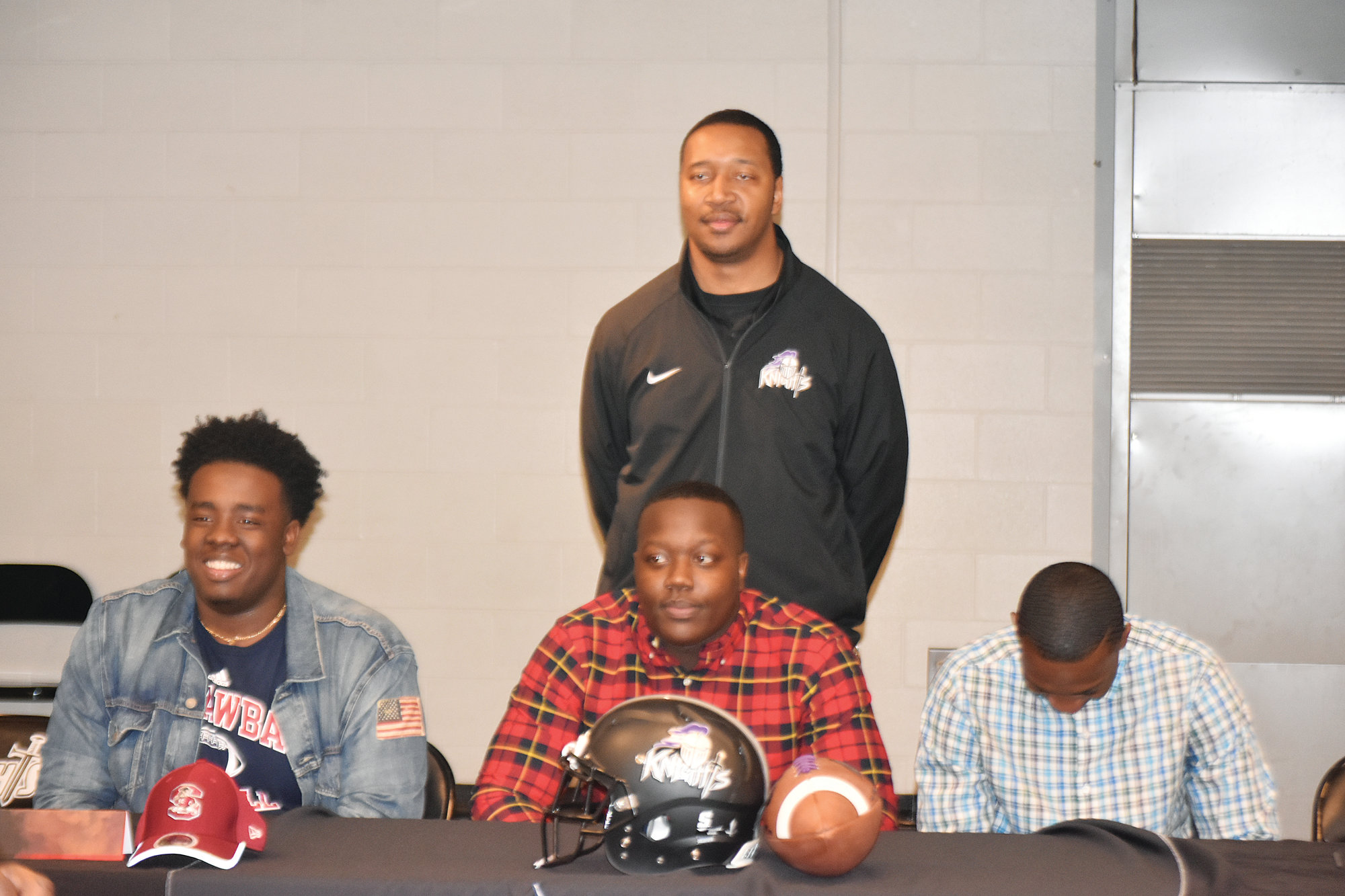 Crestwood standouts Zyricq Rufus, Terrance McClain and Anthony Bradley share a light moment  along with Knights head coach Roosevelt Nelson during a National Signing Day Event on Wednesday at the school. Rufus signed to play college football at Catawba College in Salisbury, N.C.