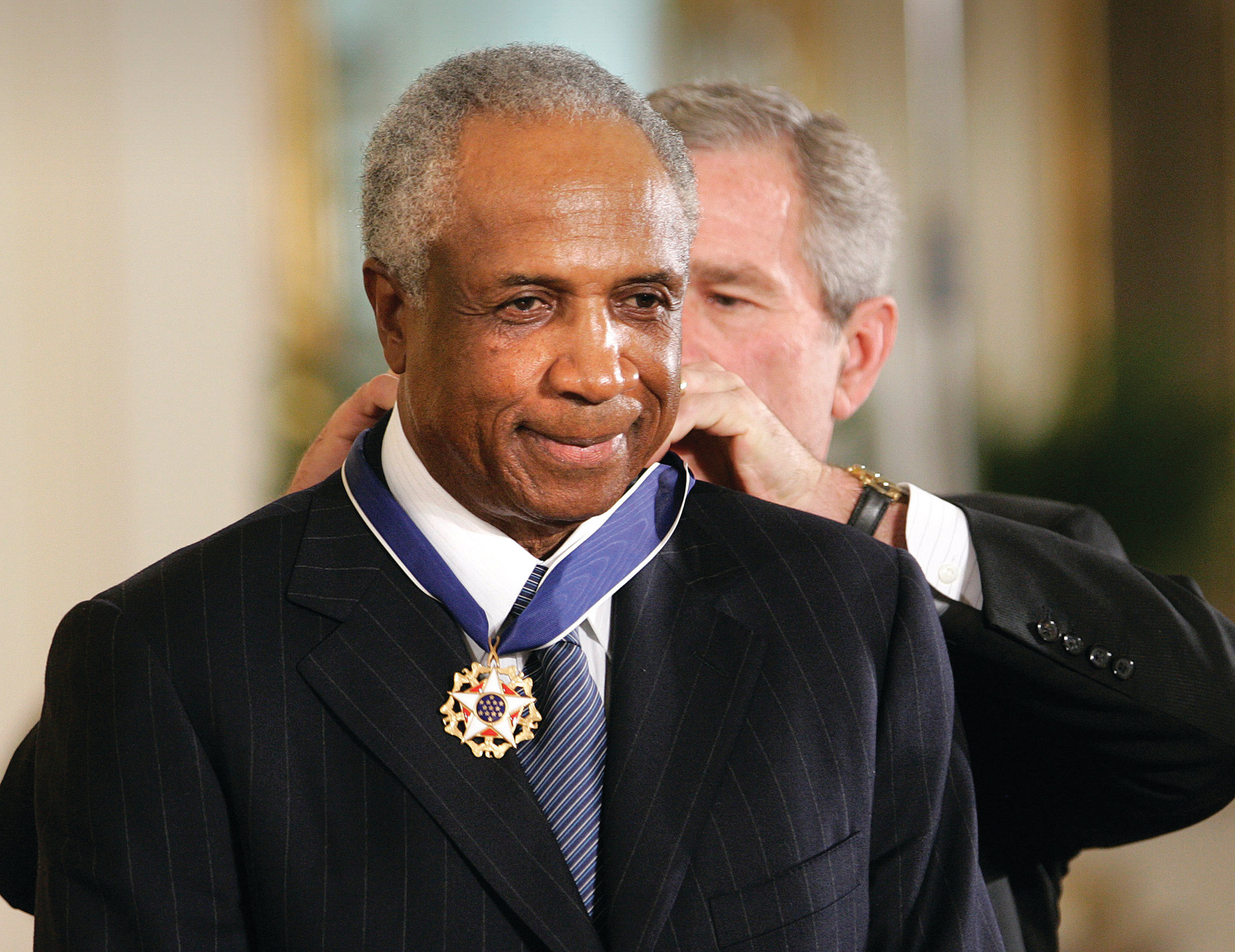 Baseball Hall of Famer Frank Robinson receives the Presidential Medal of Freedom from President George W. Bush in 2005. Robinson passed away on Friday at the age of 83.