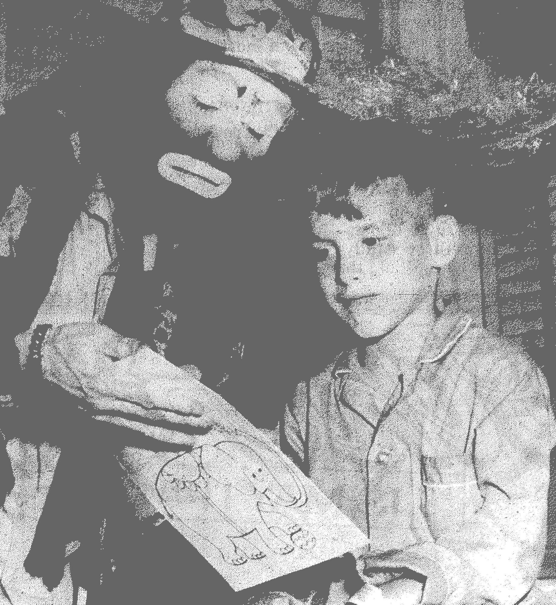 1969 - Well-known clown Emmett Kelly visited the children's ward at Tuomey Hospital to give out coloring books and entertain the children. Here he talks with Richard Elmore, age 7.