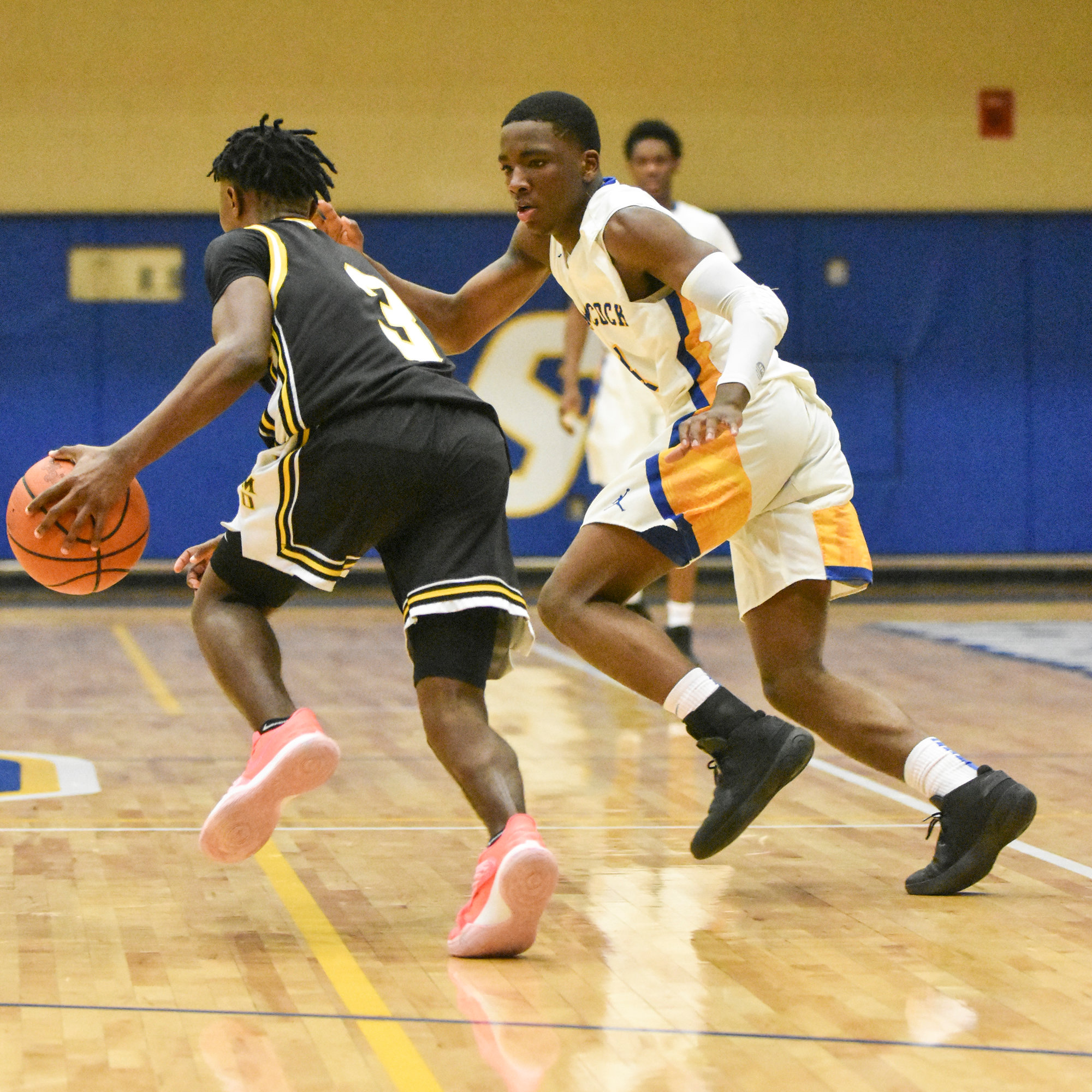Sumter's Cody McCoy defends Irmo's Dylan Williams on Friday during the Gamecocks' 60-47 loss to the Yellow Jackets in a key Region IV-5A showdown at the Sumter High gymnasium.