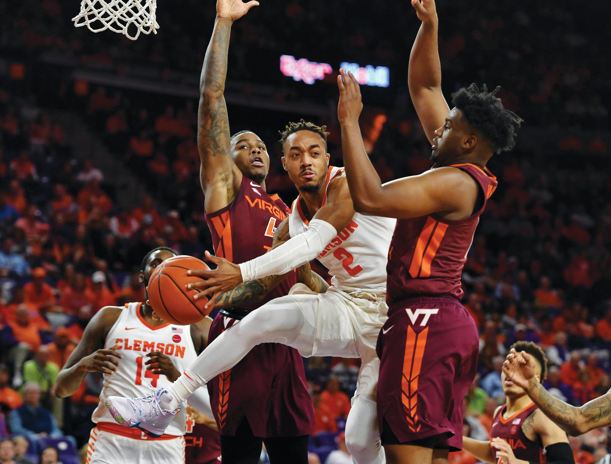 Clemson's Marcquise Reed (2) tries to pass while being defended by Virginia Tech's Isaiah Wilkins, right, and Ty Outlaw during the Tigers' 59-51 victory over the No. 11 Hokies on Saturday in Clemson.
