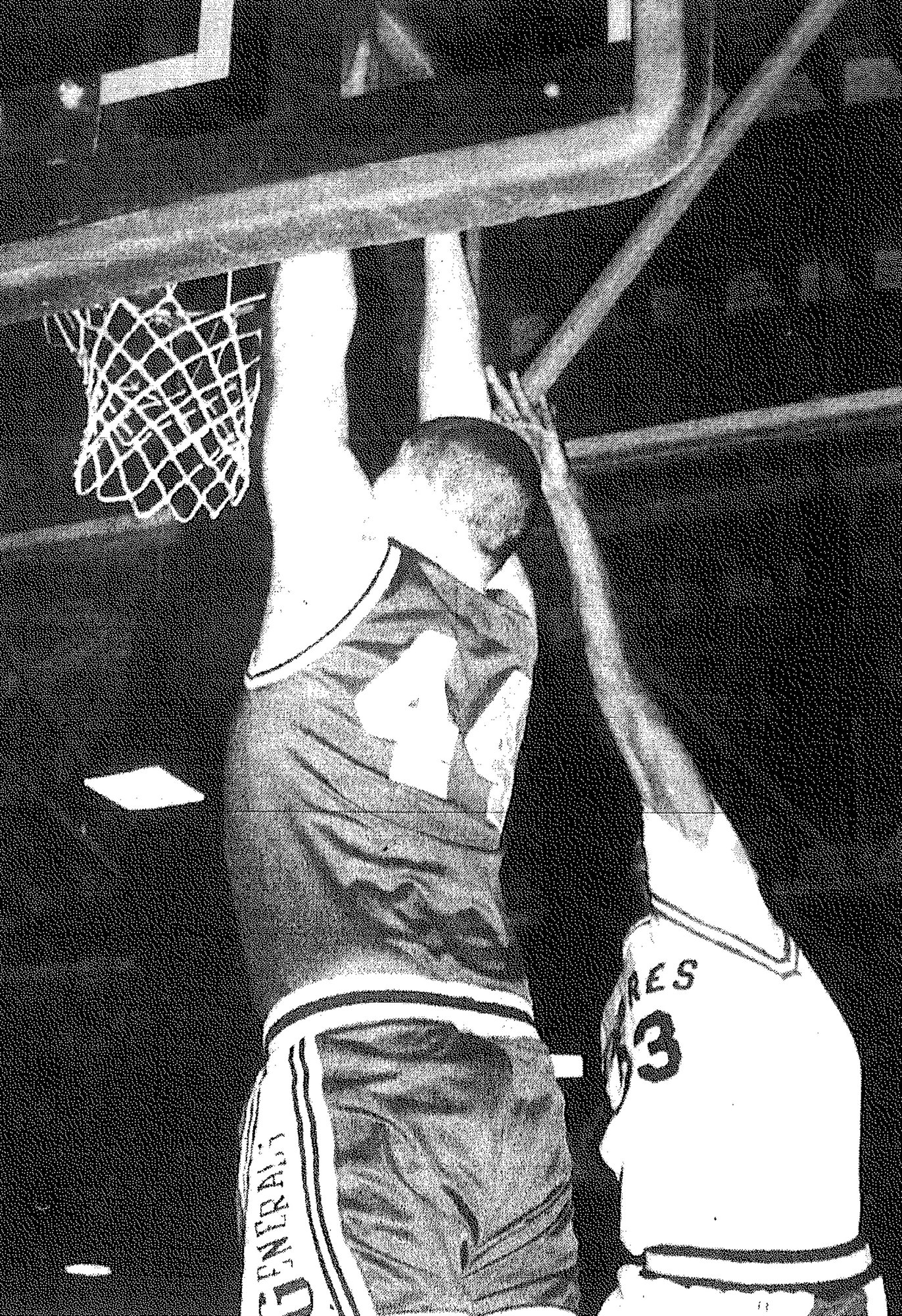 1994 - Thomas Sumter's Matt Wright dunks over Sumter Catholic's Ricardo Wilson during the Generals' 63-54 win over the Padres.