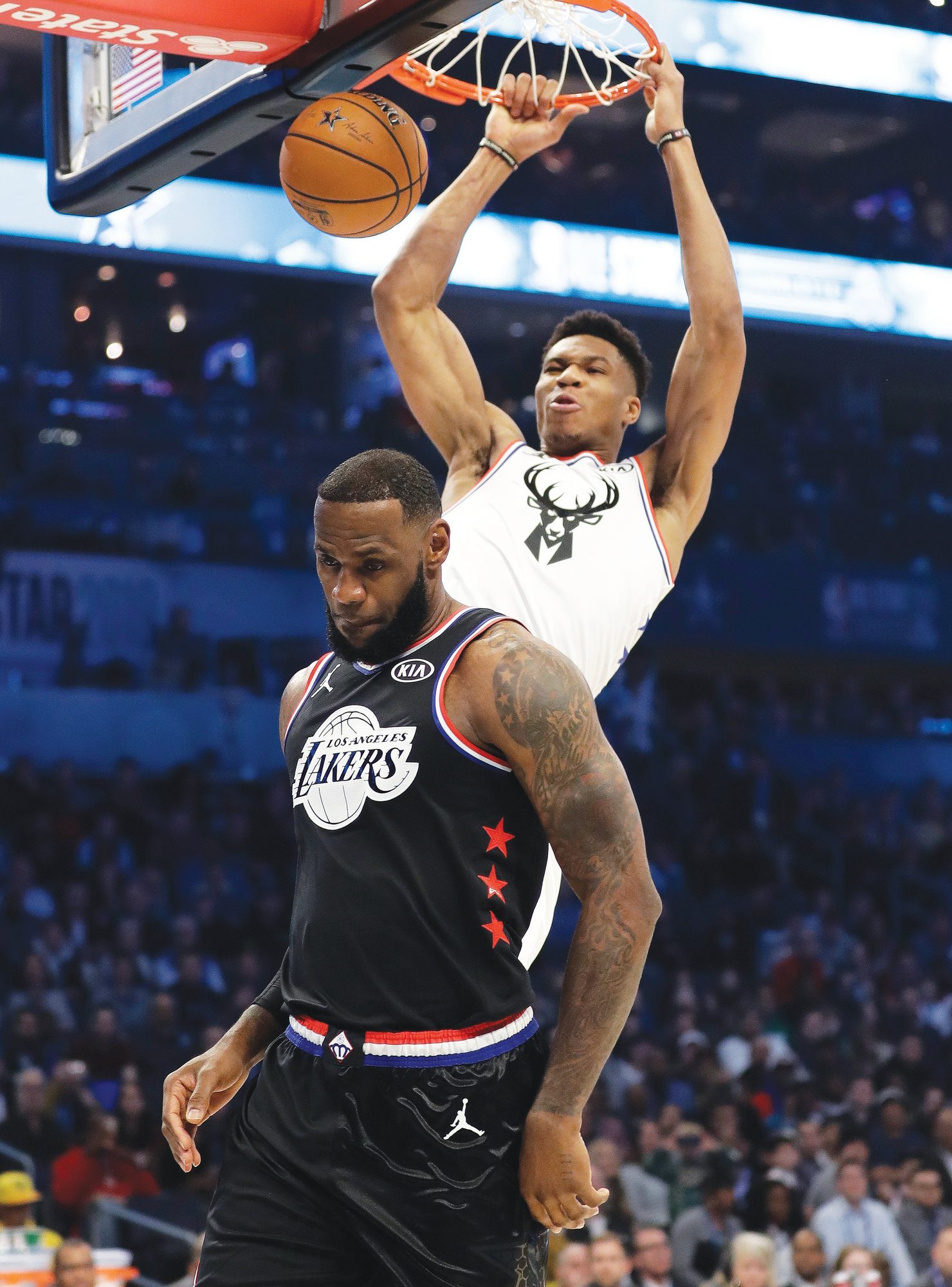 7171e8ea948 THE ASSOCIATED PRESS Team Giannis  Giannis Antetokounmpo dunks on Team  LeBron s LeBron James during Team
