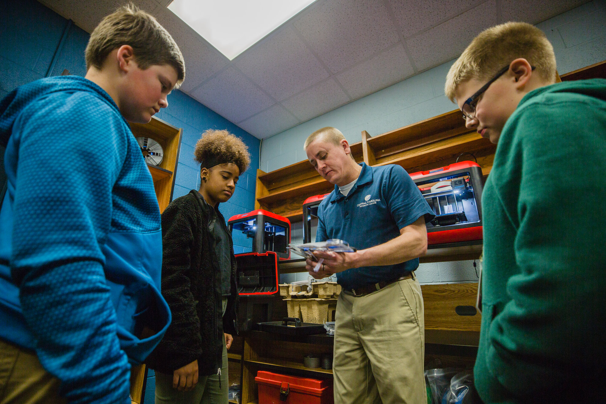 Central Carolina Technical College Engineering Design Technology Program Manager David Tuders explains parts of the new 3D printer Wednesday at ADMS.