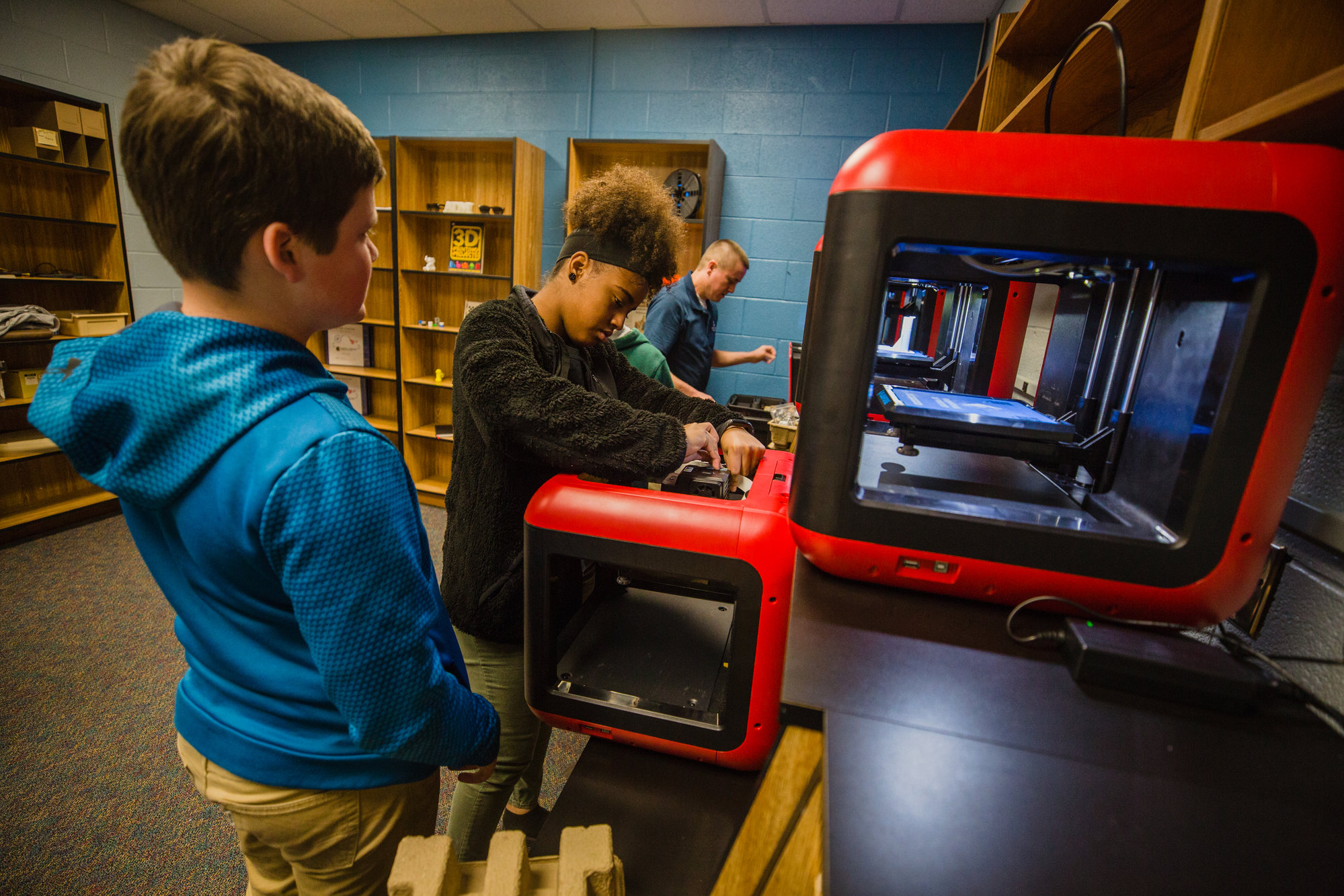 Alice Drive Middle School seventh-graders look Wednesday at the school's five 3D printers that are part of a course program in AutoCAD and engineering design.