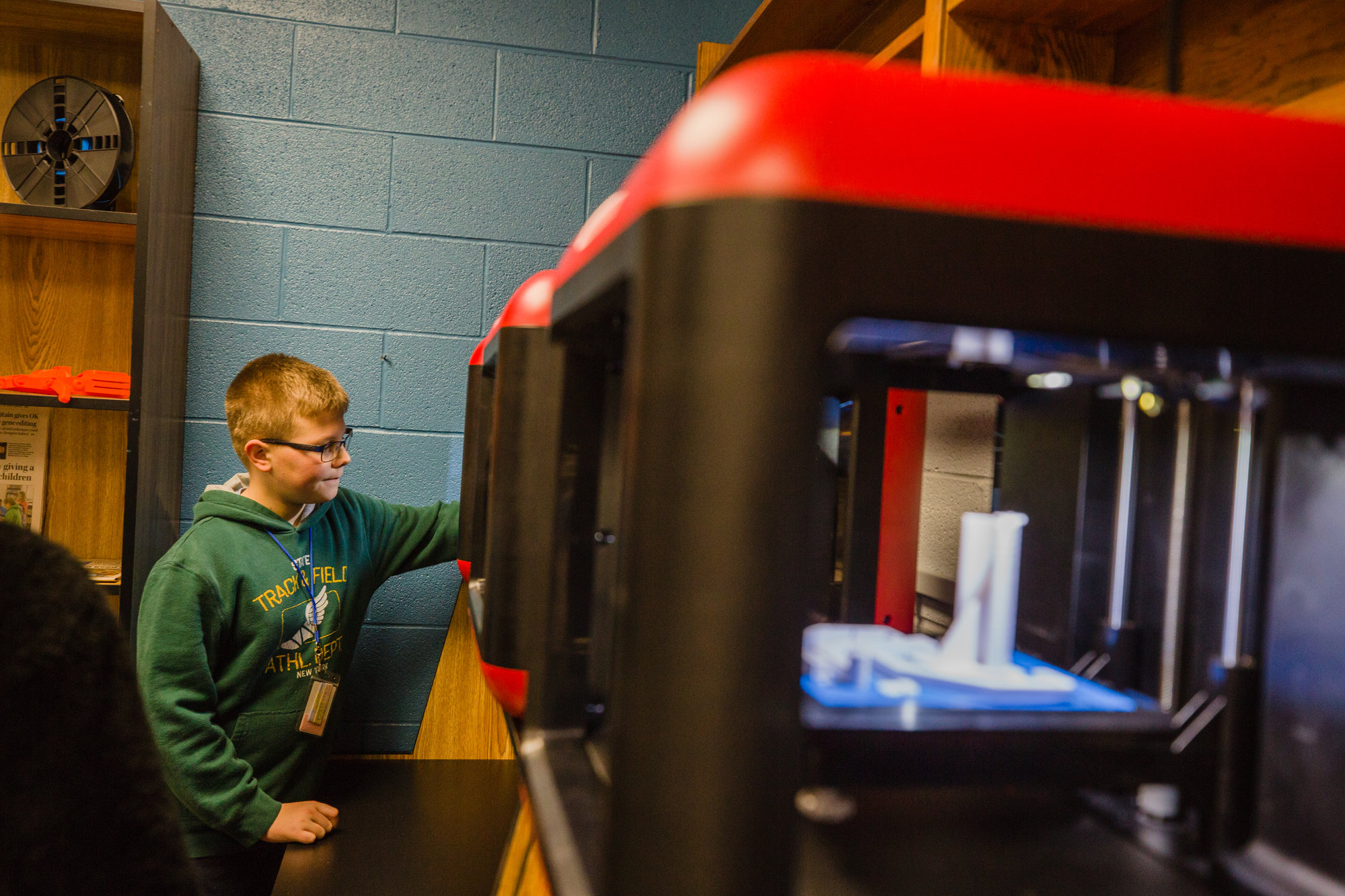 Kaden Burns, a seventh-grader at Alice Drive Middle, serves as the lab technician for the 3D printing lab at the school.