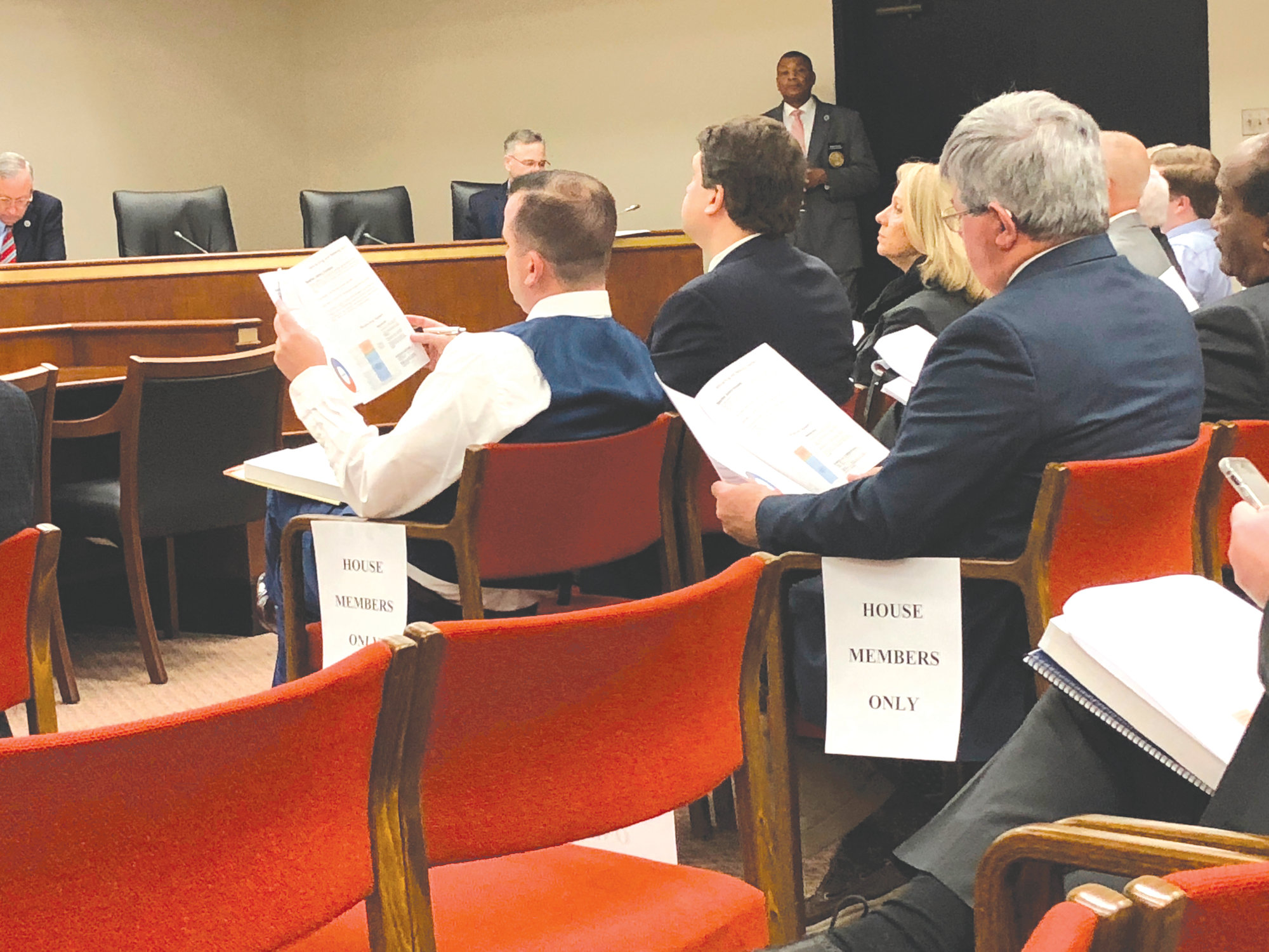 THE ASSOCIATED PRESS  South Carolina representatives look at an overview of the state's $9 billion budget on Thursday in Columbia. The state budget includes $159 million for raises for teachers.