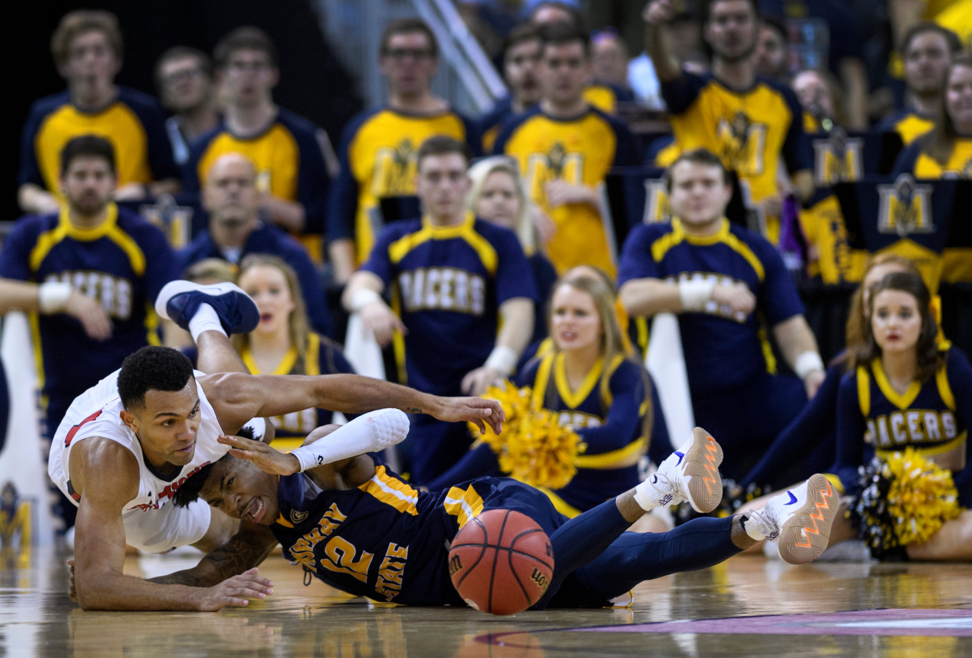 Belmont's Michael Benkert (24) and Murray State's Ja Morant (12) fight for a loose ball during the second half of the Racers' victory in the Ohio Valley Conference tournament championship game on Saturday in Evansville, Indiana.