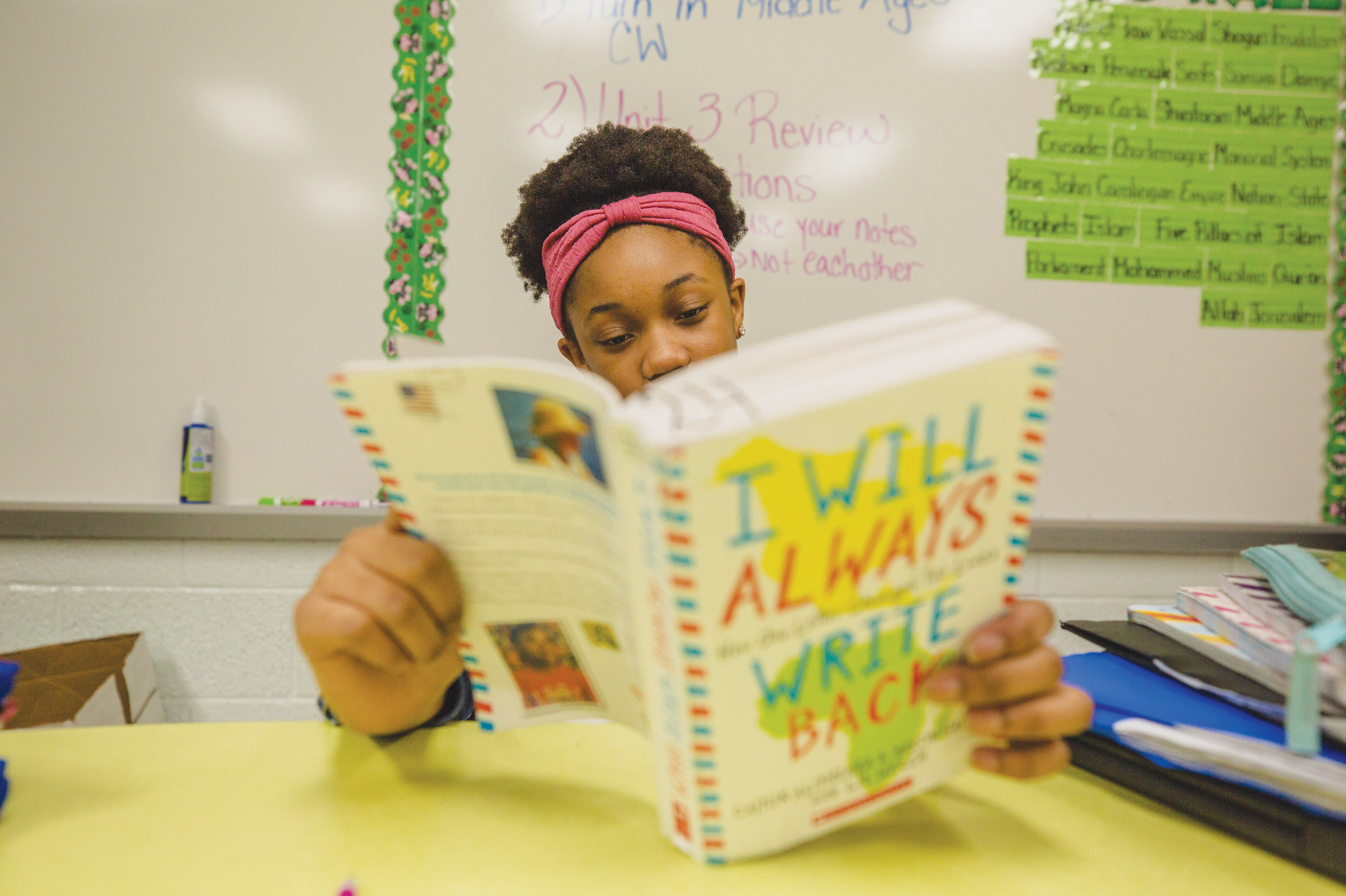 "PHOTOS BY MICAH GREEN / THE SUMTER ITEMKiondra Cooper follows along with the book ""I Will Always Write