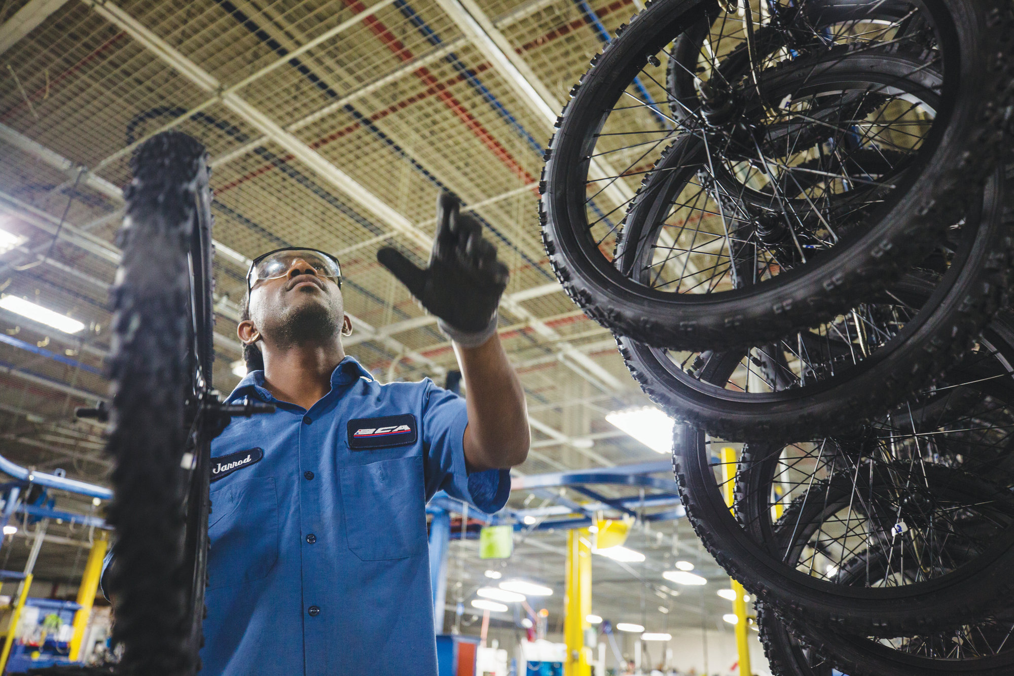 An employee of Bicycle Corporation of America, a division of Kent International, in Manning manufacture bicycles that are sold in Walmarts across the country. BCA is the only company that supplies U.S.-produced bicycles to Walmart's 4,000 stores.