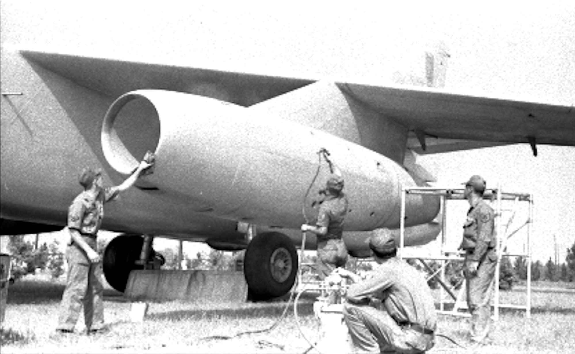 ABOVE LEFT: In 1969, airmen paint the RB-66 Destroyer which was donated to the City of Sumter and eventually returned to the Air Force. ABOVE RIGHT: City firemen and Air Force engineers remove a wing section from the aircraft After the wings and other sections were removed, the plane was towed to Poinsett Gunnery Range for use as a target in simulated fighter attacks, Air Force officials say.