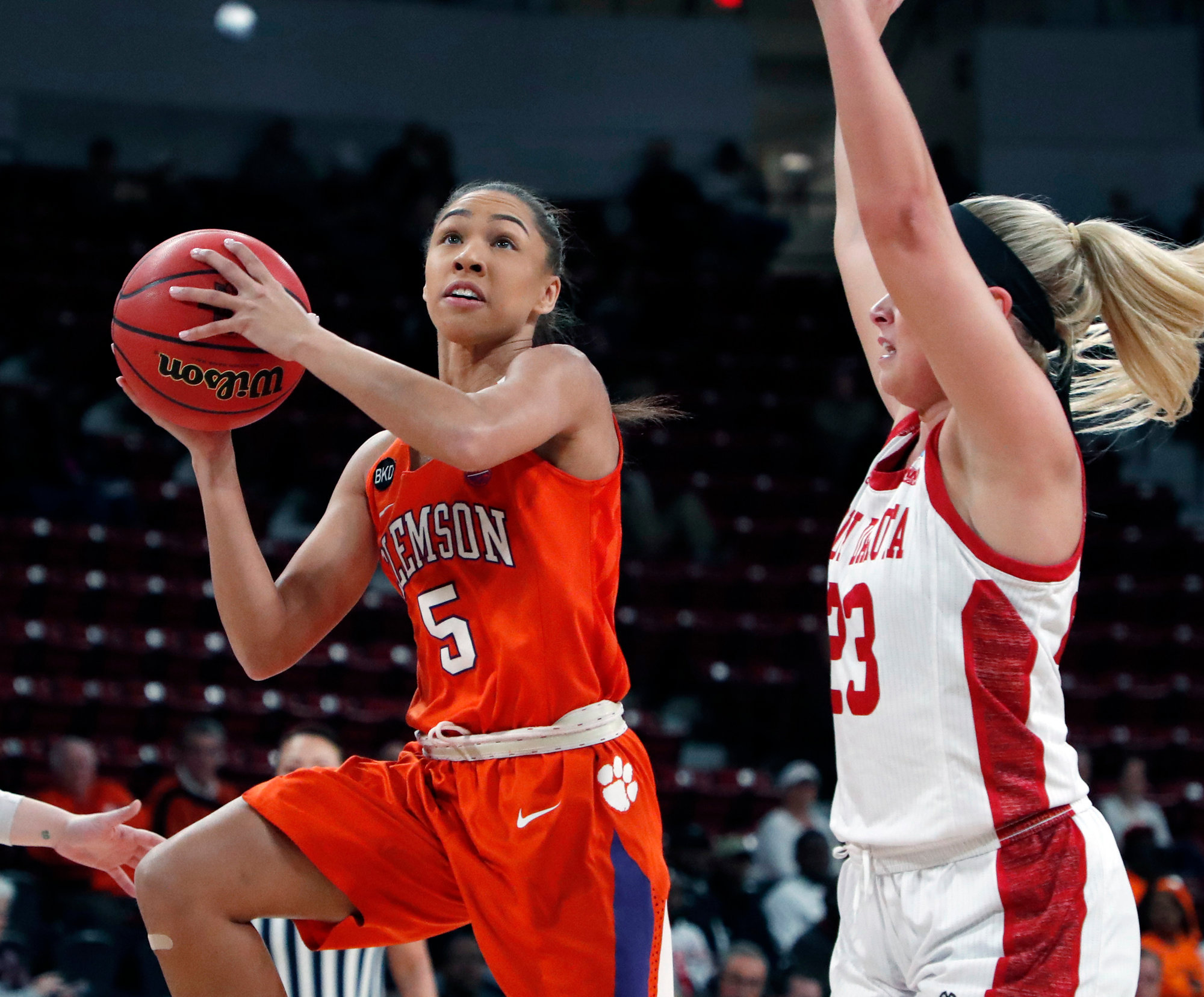 Clemson guard Danielle Edwards (5) attempts a layup while South Dakota guard Madison McKeever (23) defends during their first-round game in the NCAA Women's Tournament in Starkville, Mississippi, on Friday.