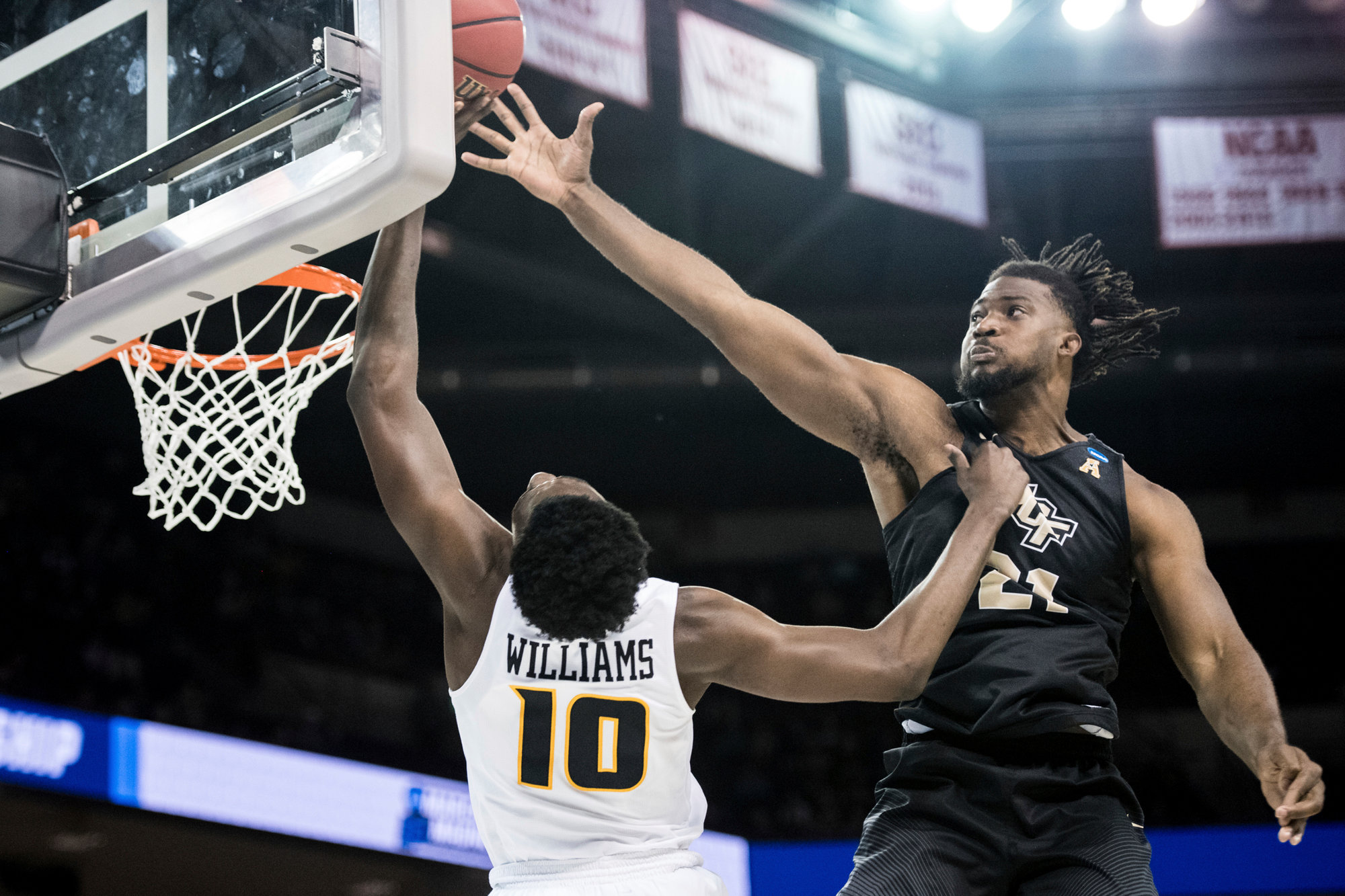 Central Florida forward Chad Brown blocks a shot by VCU guard Vince Williams during the second half of their first-round game in the NCAA men's college basketball tournament Friday in Columbia. Central Florida won 73-58