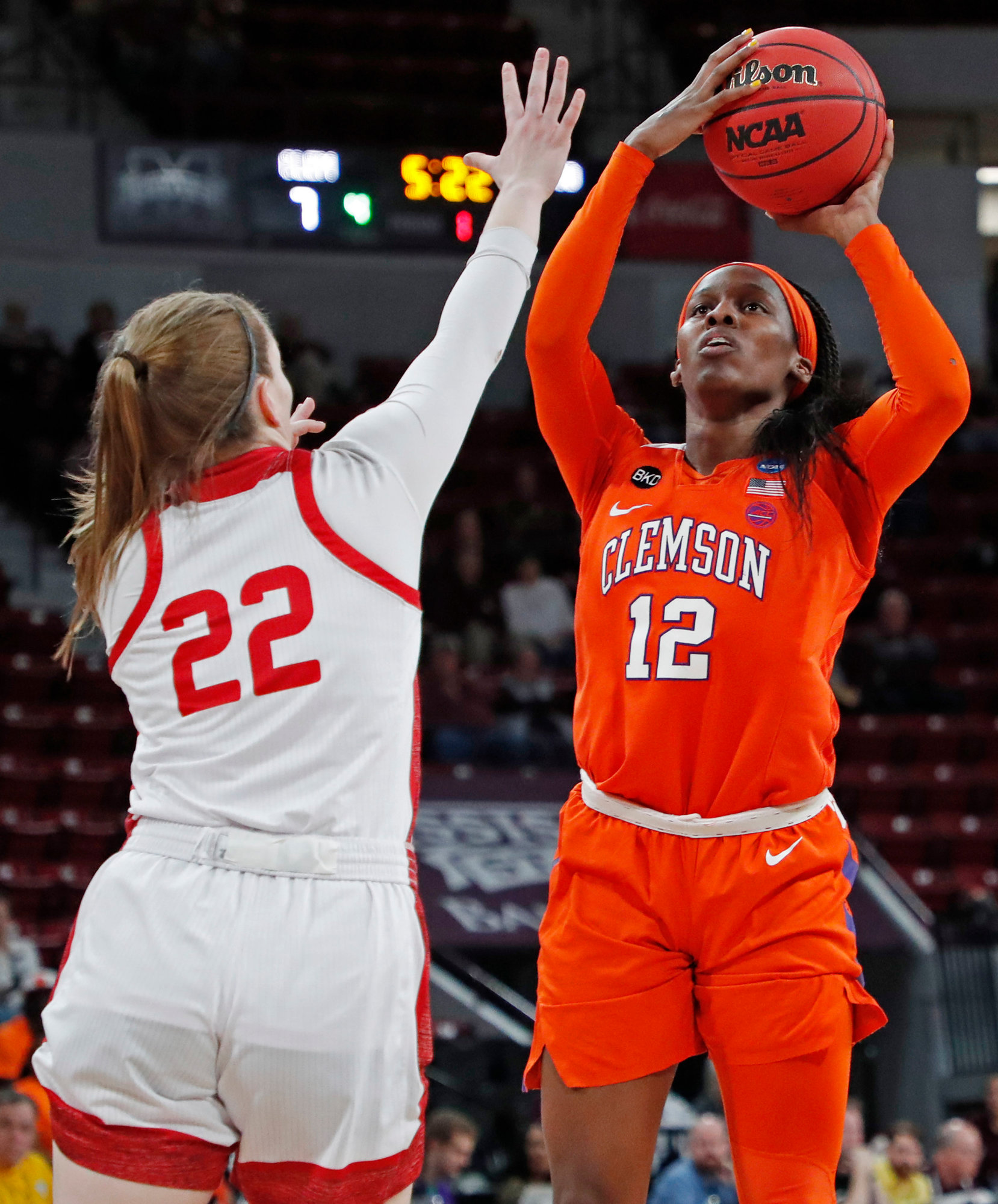 Clemson guard Aliyah Collier (12) attempts a shot while South Dakota guard Chloe Lamb (22) tries to block during a first round women's college basketball game in the NCAA Tournament in Starkville, Miss., Friday, March 22, 2019. (AP Photo/Rogelio V. Solis)