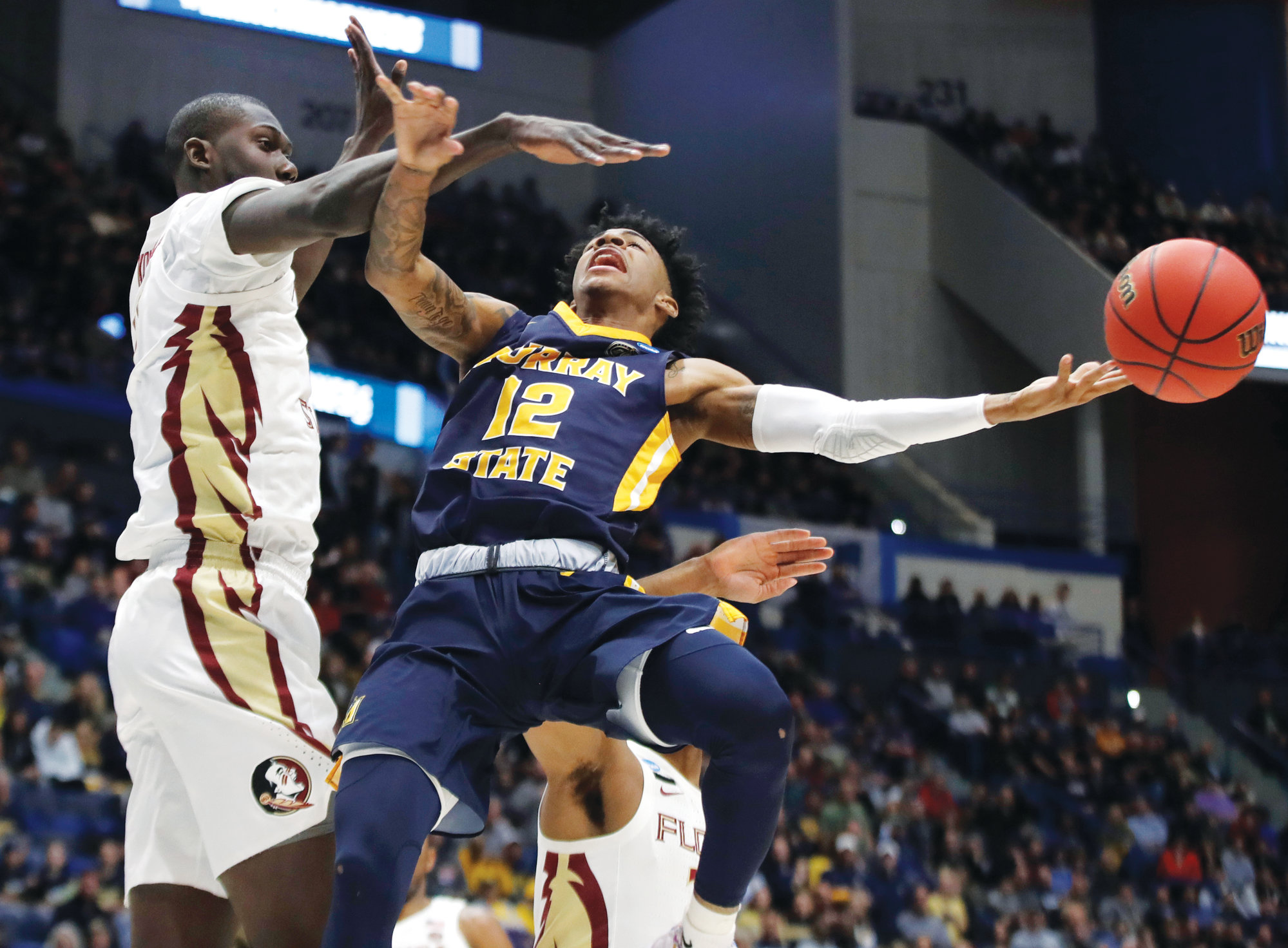 Murray State's Ja Morant (12), shown passing the ball during the Racers' NCAA Tournament game against Florida State, was named a first team All-American by The Associated Press on Tuesday. He is joined on the team by Duke's Zion Williamson and RJ Barrett, Tennessee's Grant Williams and Michigan State's Cassius Winston.