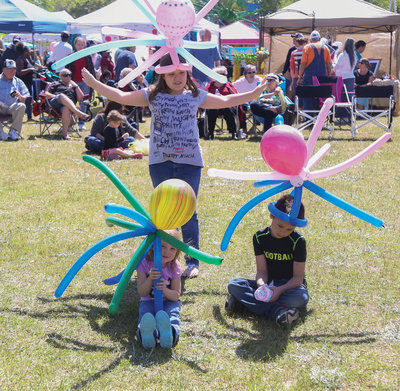 Rylee Beasley,10, Claire Beasley,3, and Brayden Gott,8, show off their octopus head gear during Turbeville's Puddin Swamp Festival on Saturday.