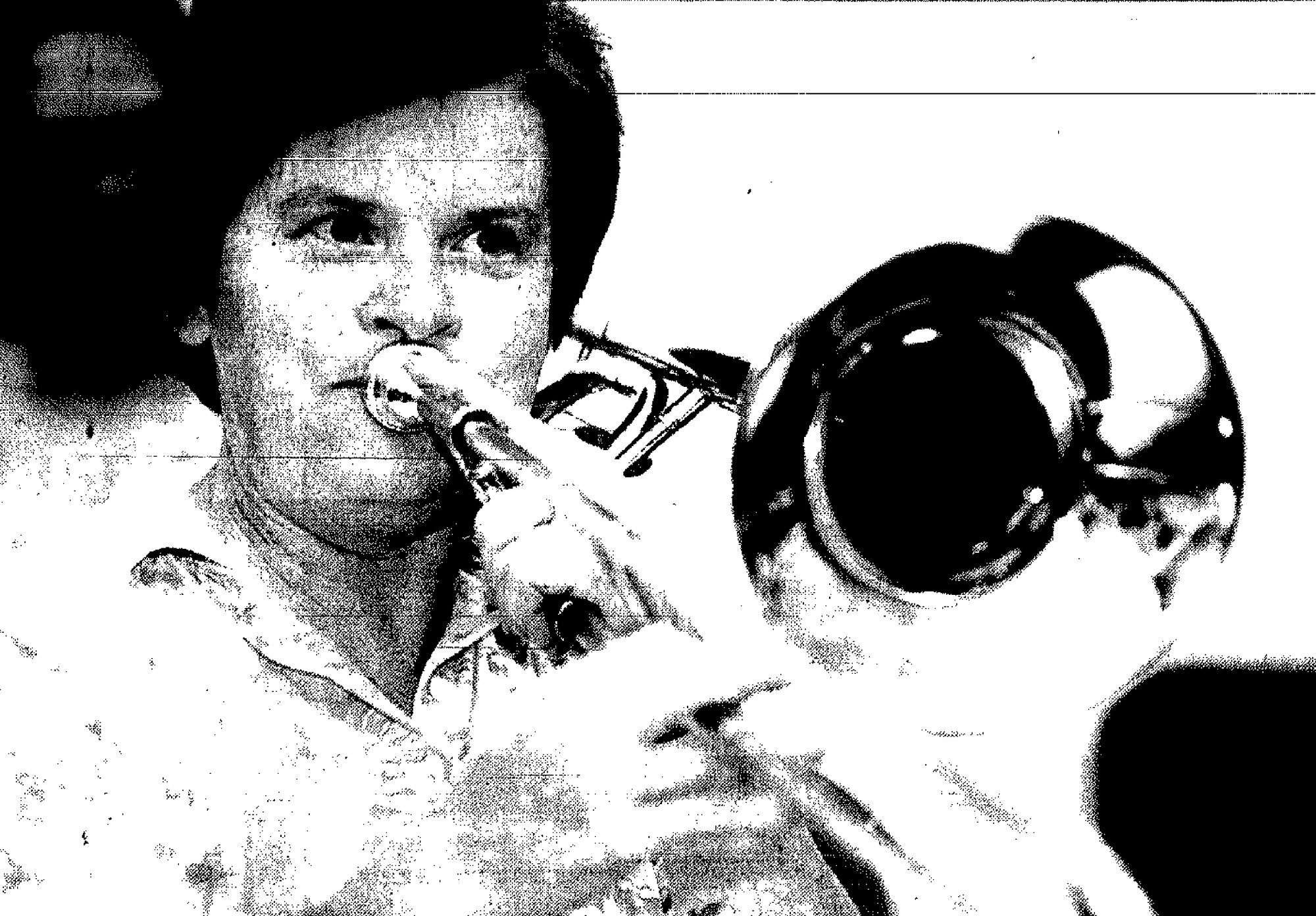 1994 - Kay Stuckey, a member of the Community Concert Band Jazz Ensemble, blows on the trombone during a rehearsal for an SPCA Musicale.