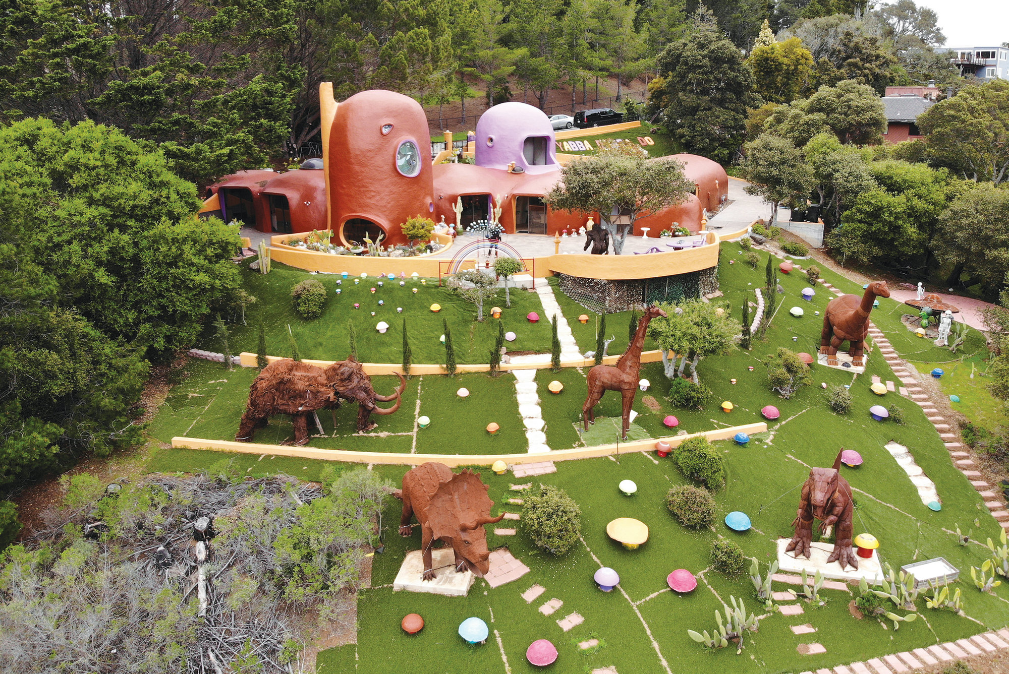Seen is an aerial view of the Flintstone House in Hillsborough, California. The San Francisco Bay Area suburb of Hillsborough is suing the owner of the house, saying that she installed dangerous steps, dinosaurs and other Flintstone-era figurines without necessary permits. The owner and her attorney say they will fight for the rights of property owners and Fred and Barney fans everywhere.