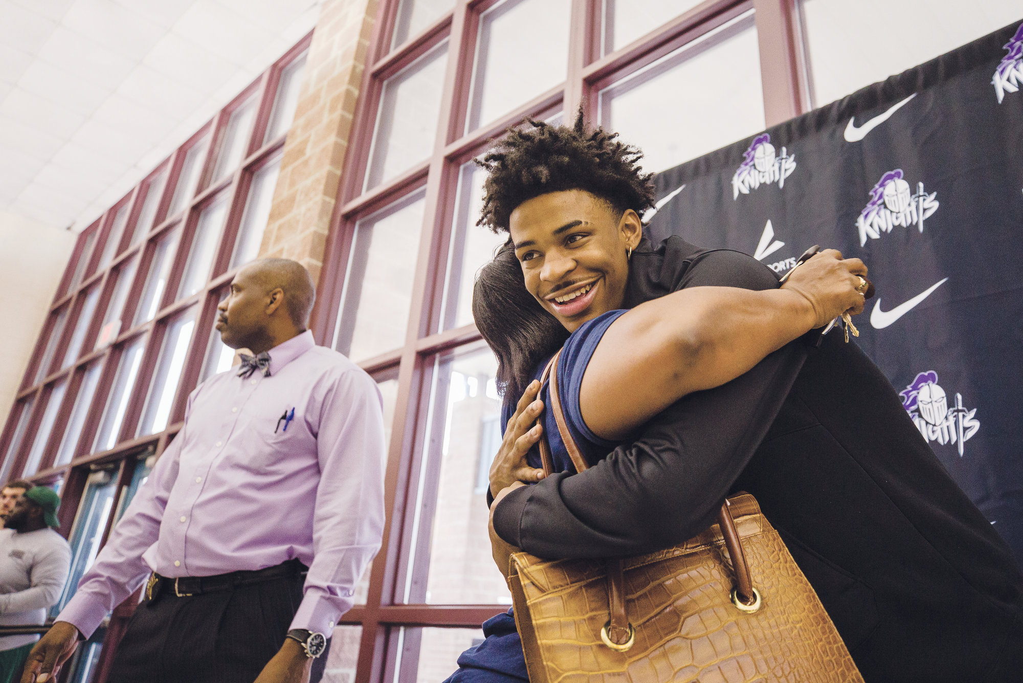 Morant hugs a fan during the Ja Morant Day celebration at Crestwood High School, Morant's alma mater, on Monday