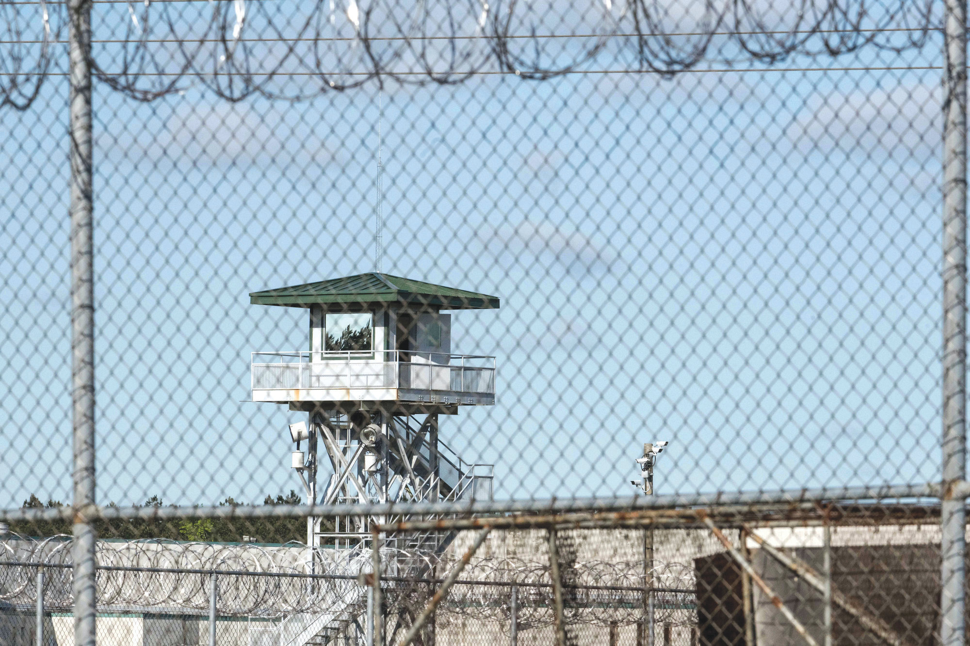 A guard tower stands above the Lee Correctional Institution, a maximum-security prison in Bishopville,  the morning after seven inmates were killed amid fighting among prisoners in April 2018.