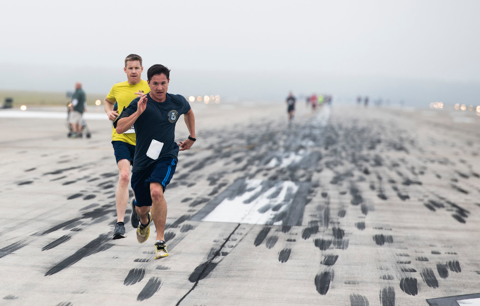 Team Shaw members run the final stretch during a flightline 5K at Shaw Air Force Base on Saturday. During the run, military members received the opportunity to build camaraderie with their civilian counterparts in a healthy and lively way.