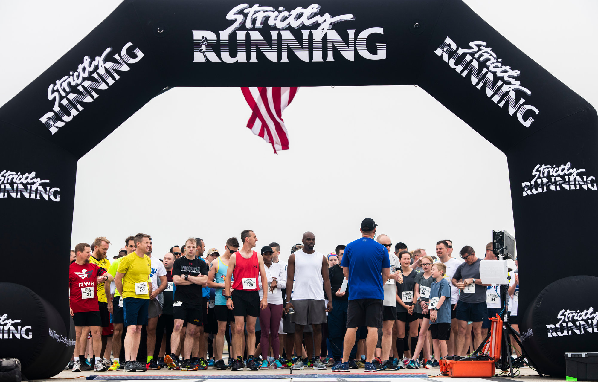 PHOTOS BY U.S. AIR FORCE SENIOR AIRMAN CHRISTOPHER MALDONADO / SPECIAL TO THE SUMTER ITEM  Team Shaw and local community members wait at the starting line of a flightline 5K race at Shaw Air Force Base on Saturday. Participants received a running bib, commemorative water bottle and other flightline 5K mementos.