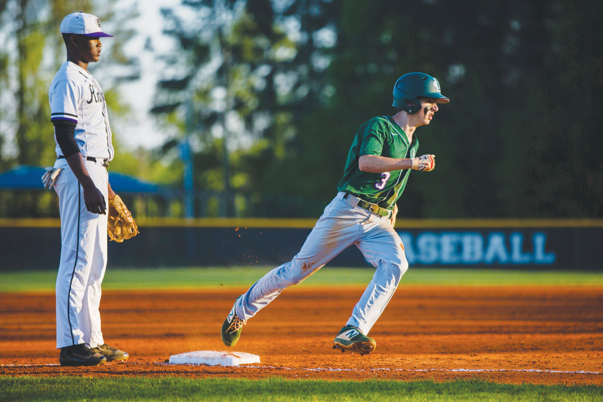 Lakewood's Ian Morris rounds third base on his way to scoring a run during the Gators' 12-1 victory over Crestwood on Wednesday at the Crestwood field.