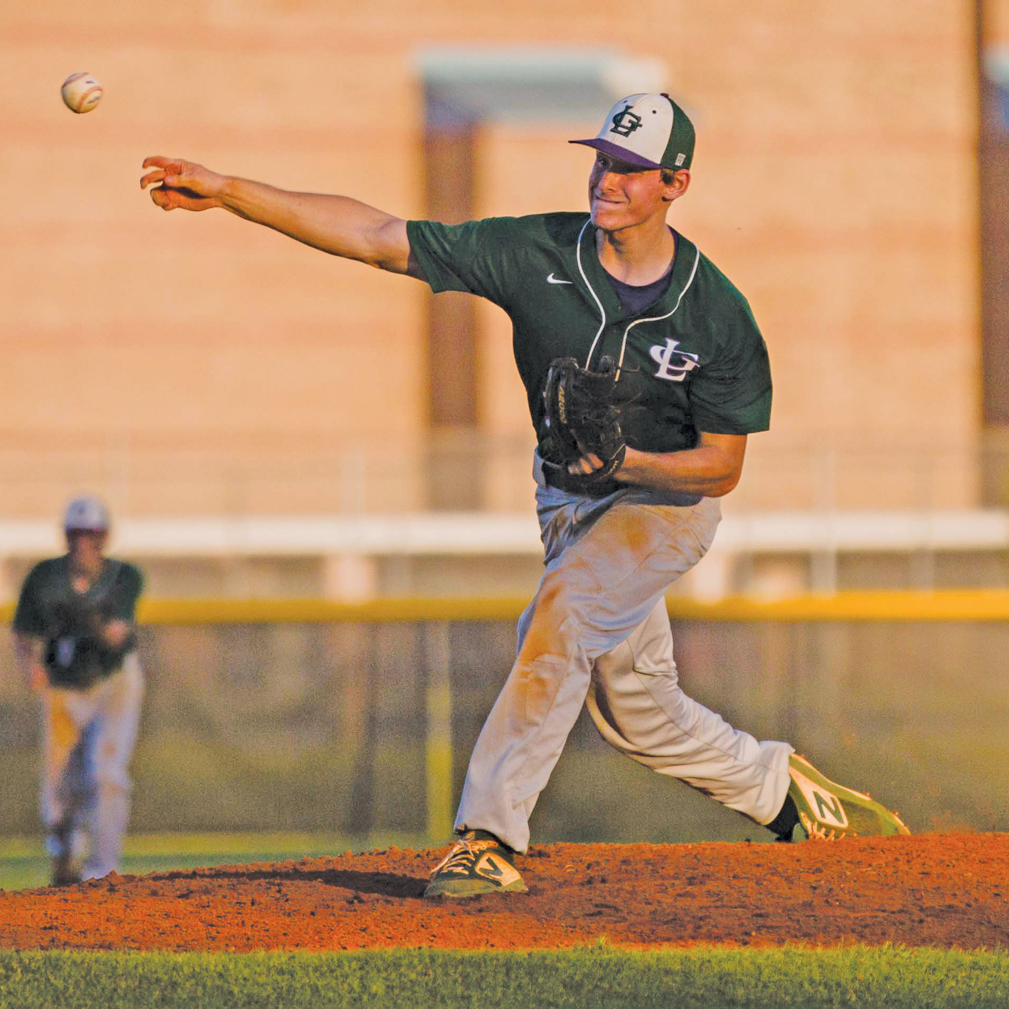 Lakewood's Cody Windham delivers a pitch during the Gators' 12-1 victory over Crestwood on Wednesday at the Crestwood field.