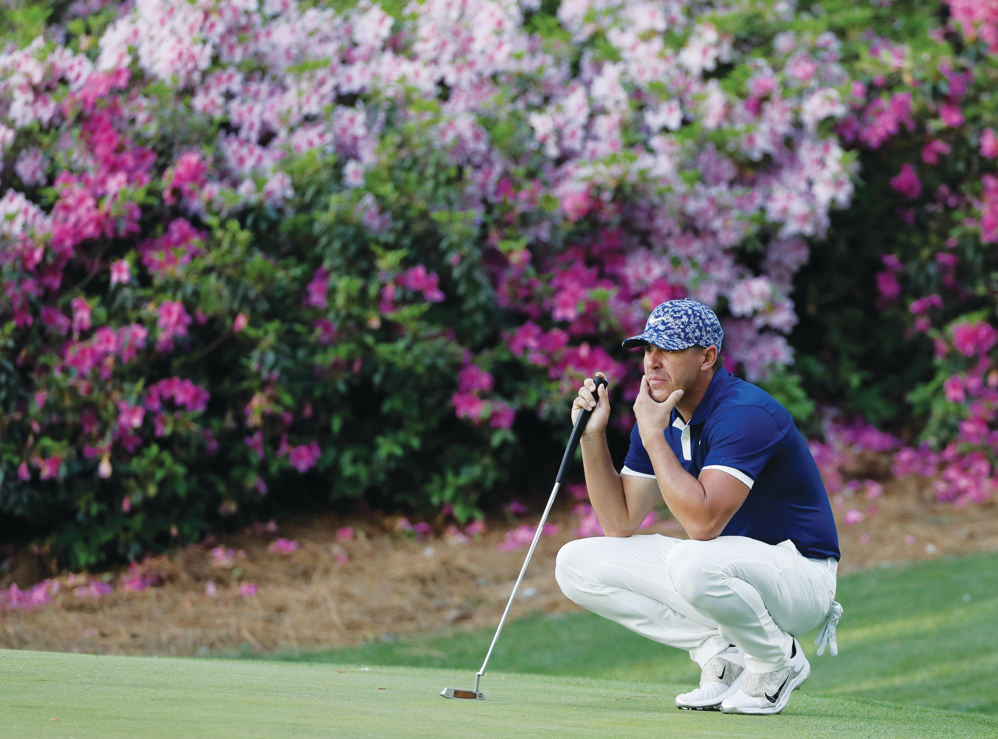 Brooks Koepka looks over a putt on the 13th hole during the first round for the Masters golf tournament Thursday in Augusta, Georgia. Koepka moved into the lead with a series of birdies on the back nine that left him 5 under par, ahead of several players tied for second place at 4-under.