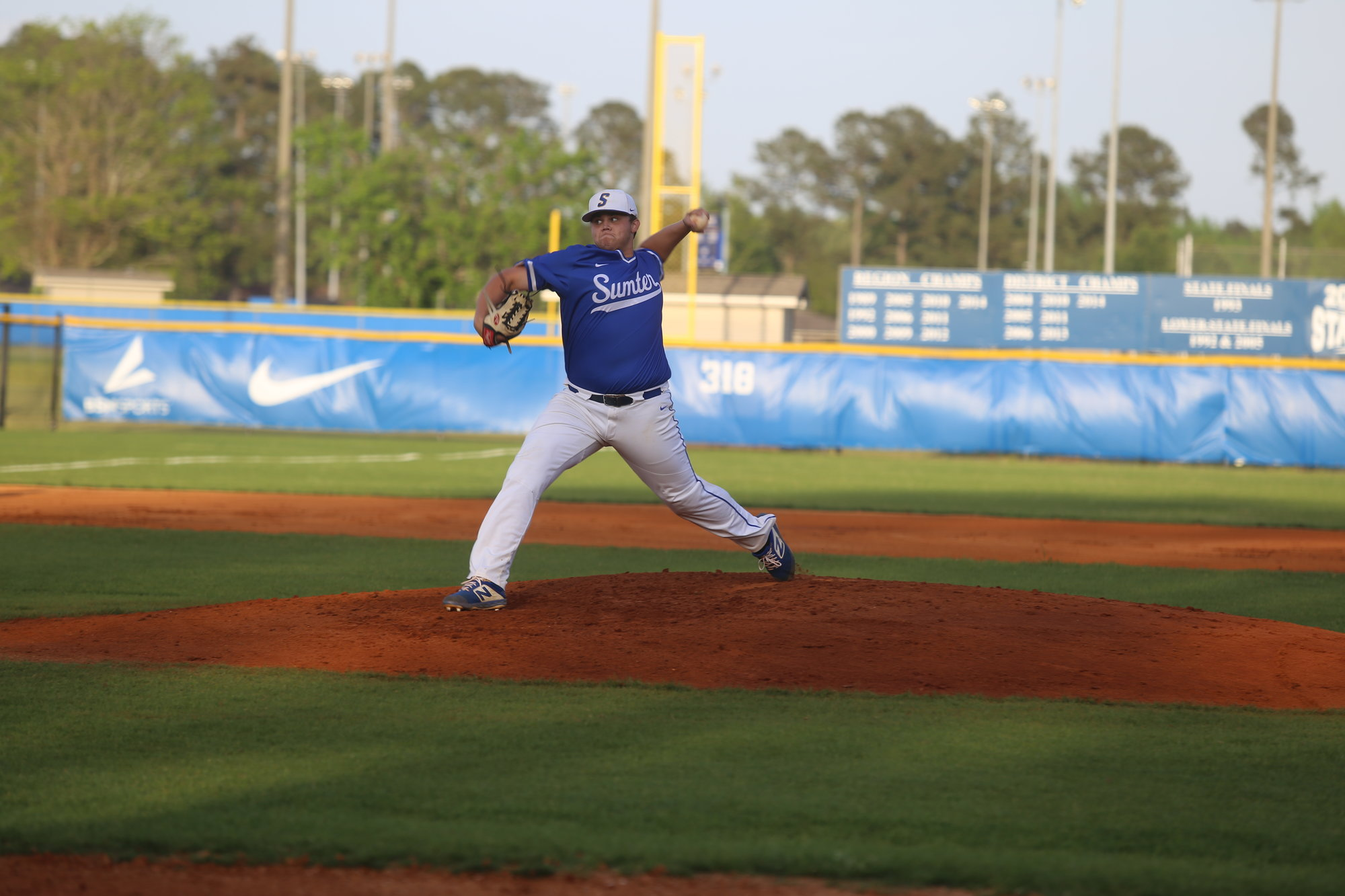 Sumter pitcher Josh Bryant delivers a pitch during the Gamecocks' 3-2 loss to Irmo on Thursday night at home. Bryant finished with nine strikeouts, issued one walk and gave up four hits and three runs, all of them earned, in 4 2/3 innings.