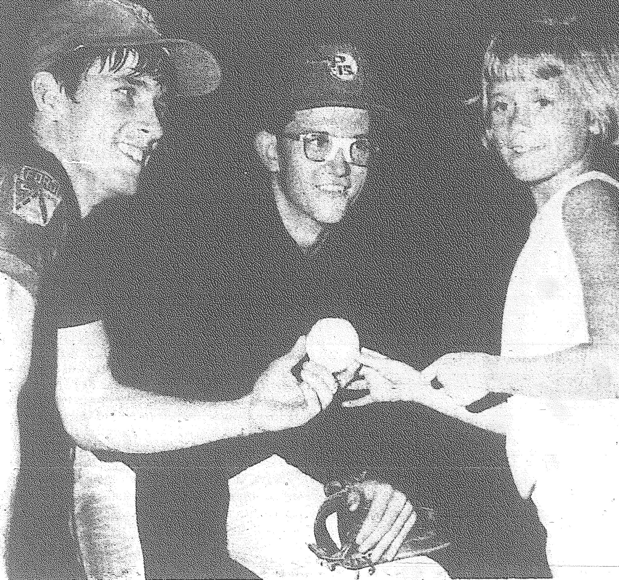 1969 - Em Brown, who has been a loyal fan of the Sumter P-15's the entire season, asked for and got autographs of the team at the final game of the 1969 season in Manning on July 12. She's seen with the two leading stars in the 7-2 victory by Sumter, Donnie Branham, left, and Ricky Barkley. Barkley hurled the win, a four-hitter, while Branham had three hits.
