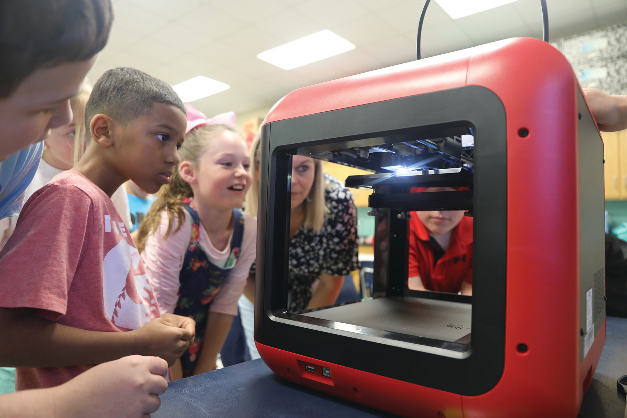 Alice Drive Elementary School teacher Lisa Jackson's fourth-grade class visited Kristi Waldron's STEM classroom lab to see how the new 3-D printer from Central Carolina Technical College works.