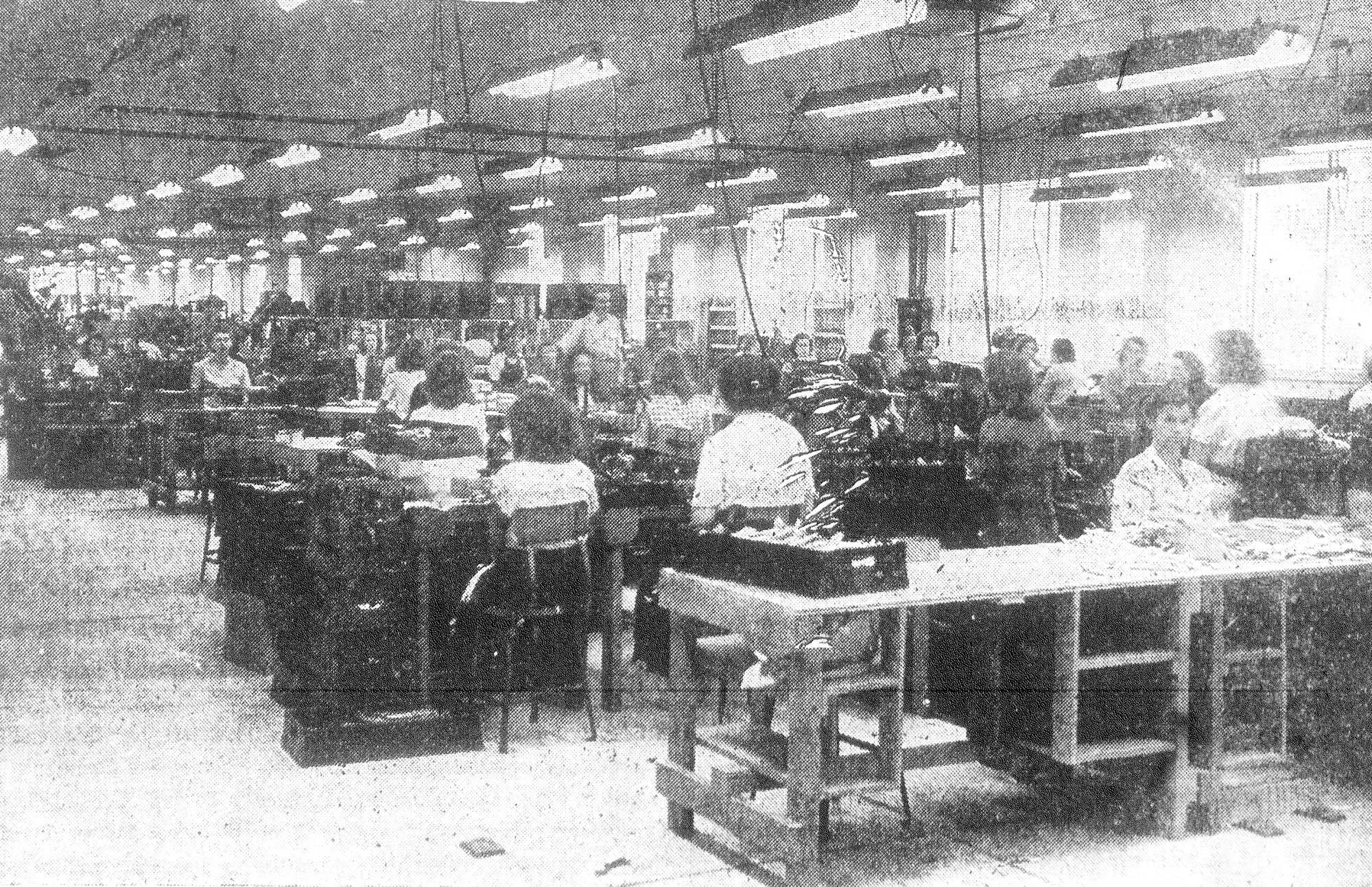 This photo shows the Final Assembly Department, where zippers were given their final inspection for quality.