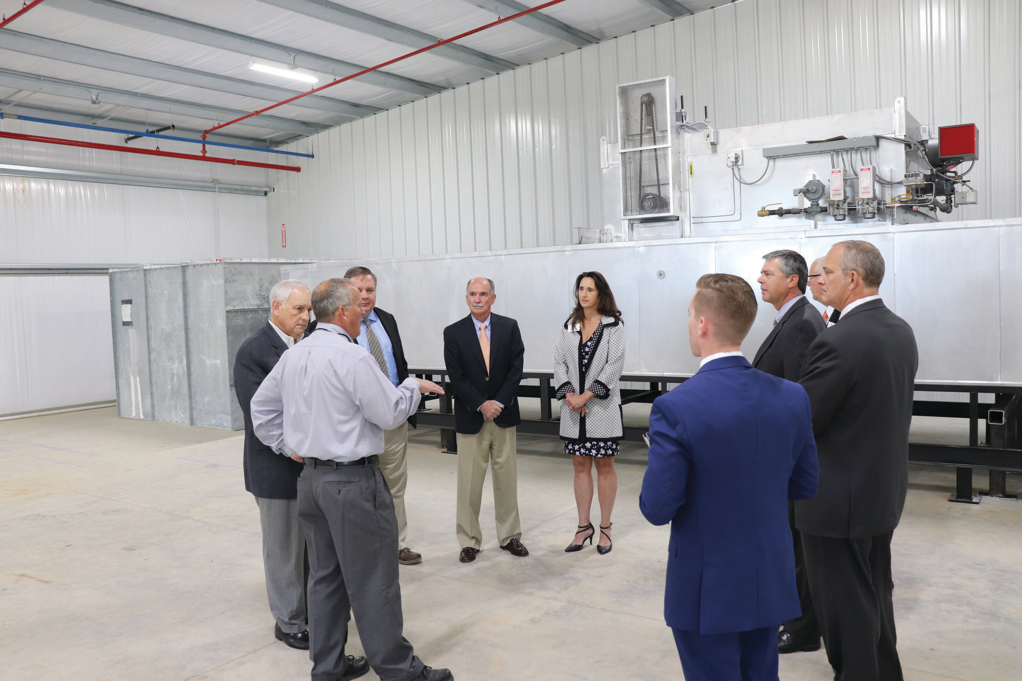 Carolina Metal Finishing Plant Manager John Gibart discusses his operations recently with local, area and state partners in the Rural Modernization Program Loan initiative.