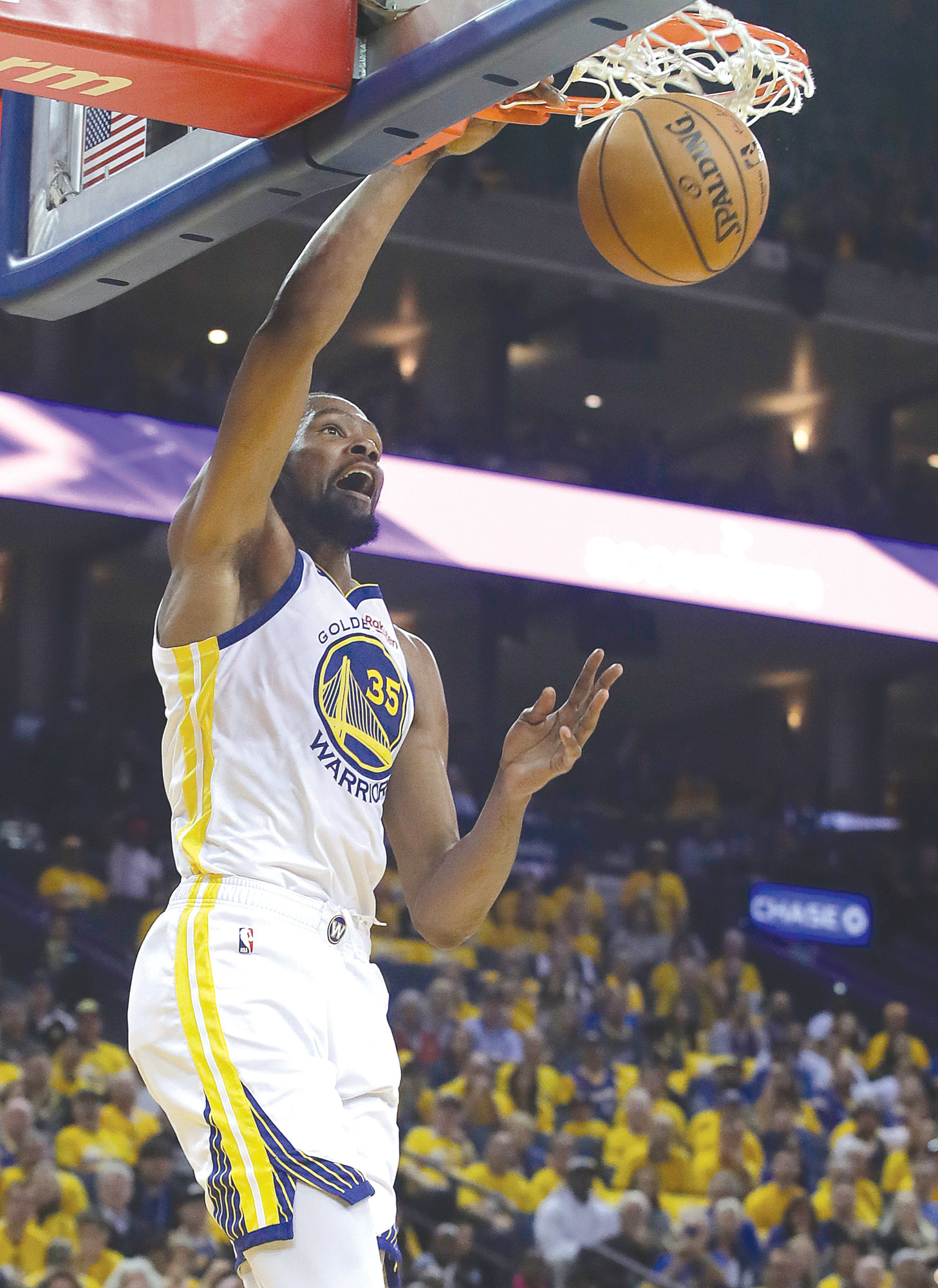 2d4af3494e18 ... Warriors-Rockets Game 1. THE ASSOCIATED PRESS Golden State Warriors  forward Kevin Durant (35) dunks against the Houston