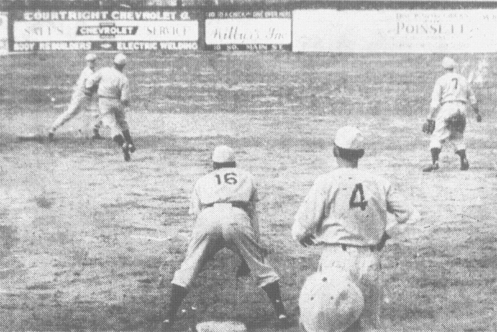 Infield action - Jack Sofia, shortstop for the winners, attempts to complete  a double play in the intra-squad game at Riley Park on March 30, 1949, between two Sumter teams. The runner was forced at second, but the batter was safe at first. No. 16 is Joe Sabatella, No. 4 is Raymond Pate, and No. 7 is Fred Daniels.