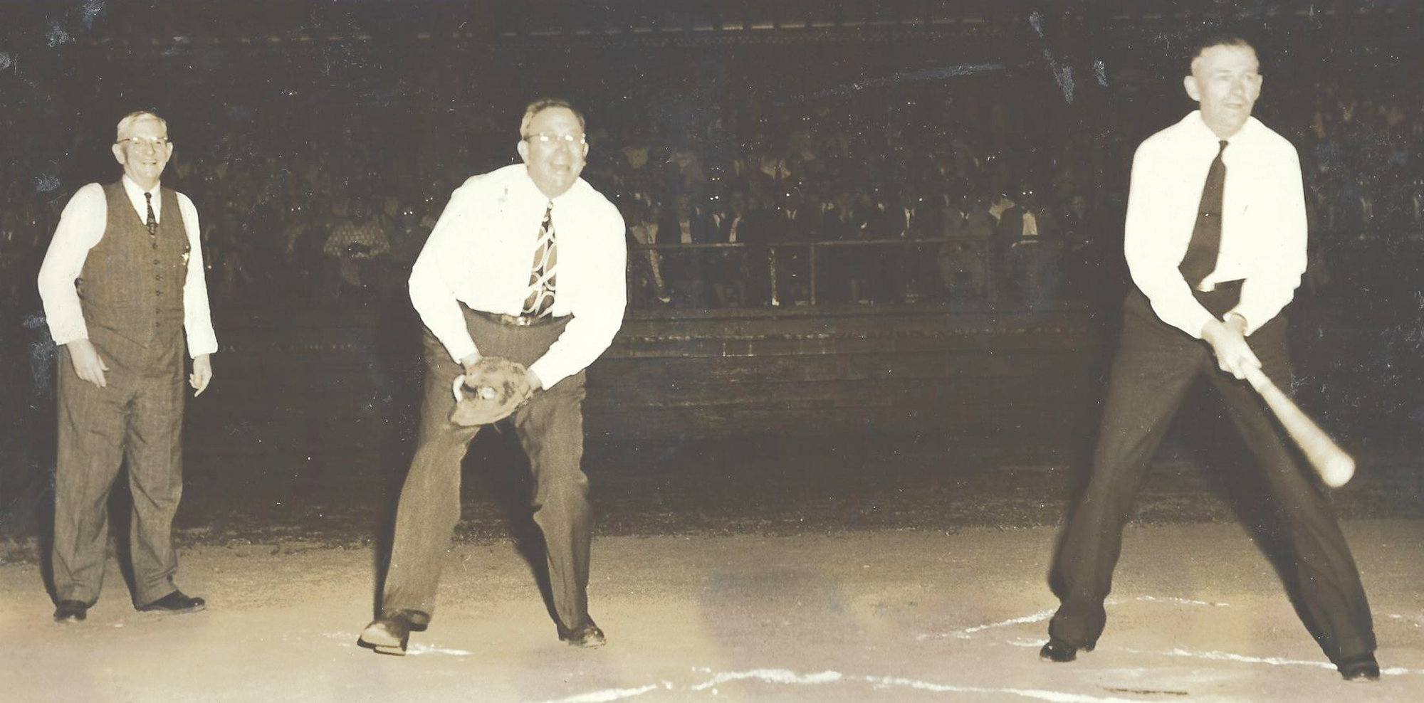 "During the preliminary events which marked the opening of the Sumter Chicks' home season in 1949 was the ""all-star"" game played just before the Chicks tangled with the Florence Steelers. Players included, from left, City Manager J. A. Raffield as umpire, former U.S. Congressman John J. Riley as catcher and Mayor W. E. Bynum as batter. Gov. J. Strom Thurmond was one of the visitors and made a brief address and served as pitcher for the ""all-star"" game."