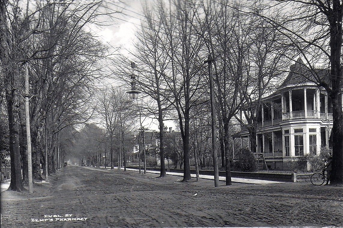 A view of Church Street looking north from the intersection with W. Hampton Avenue shows the well-maintained streets constructed using techniques used by Scottish engineer John L. McAdam. Before brick pavers, some residents preferred the quiet of passing carriages and horses on dirt until the streets were paved with brick pavers between 1915-1920.