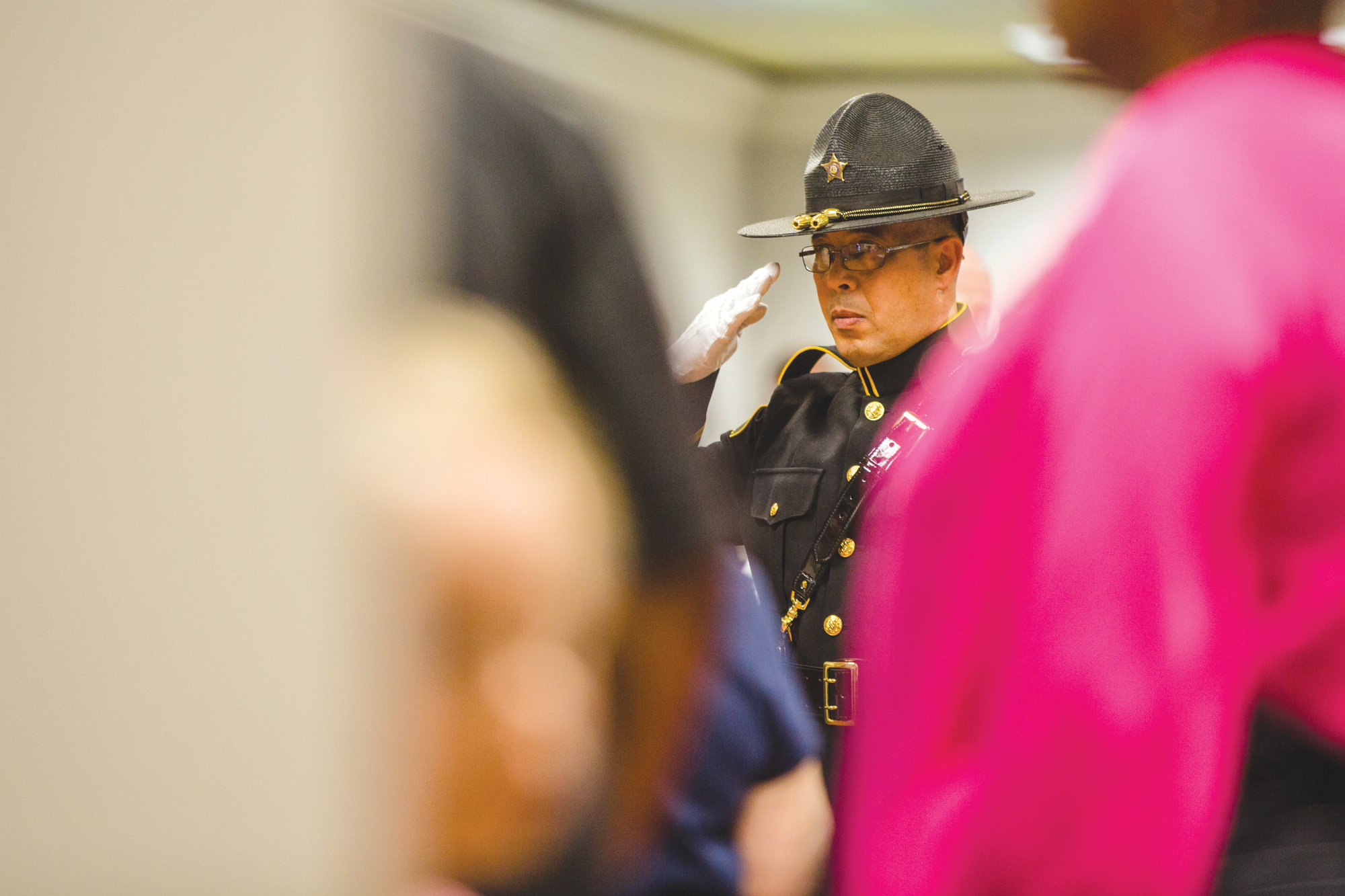 A member of the Sumter County Sheriff's Office Honor Guard salutes during a memorial for fallen officers.