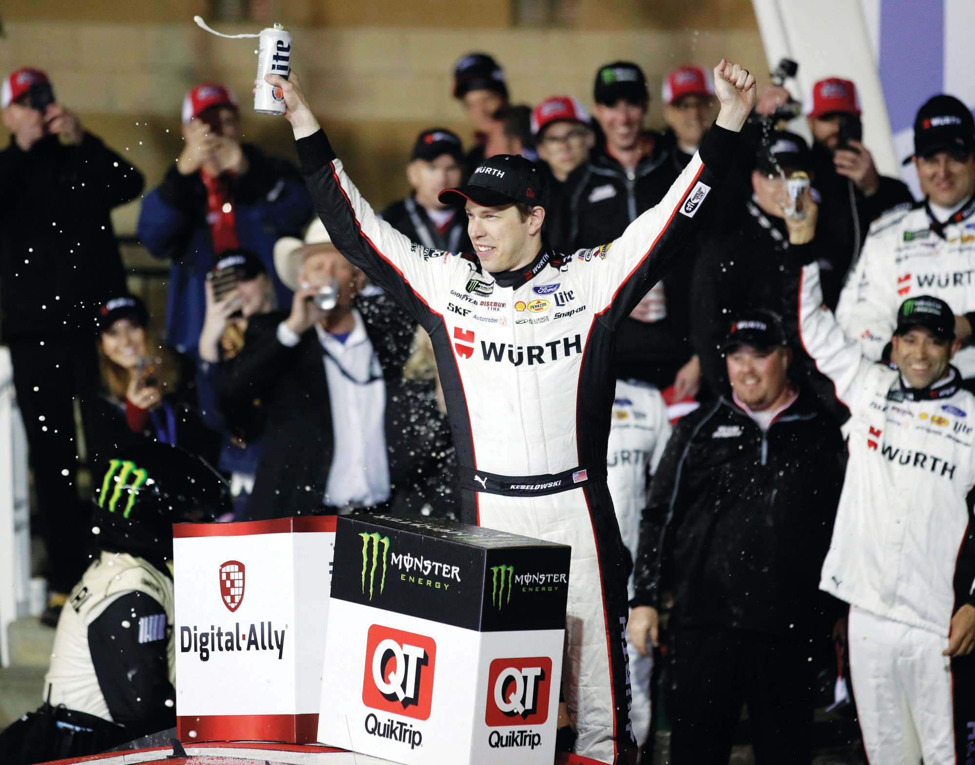 Brad Keselowski celebrates his Monster Energy Cup Series victory at Kansas Speedway in Kansas City, Kansas, on Saturday. The month of May is a big month for both NASCAR and the Indy Racing League.