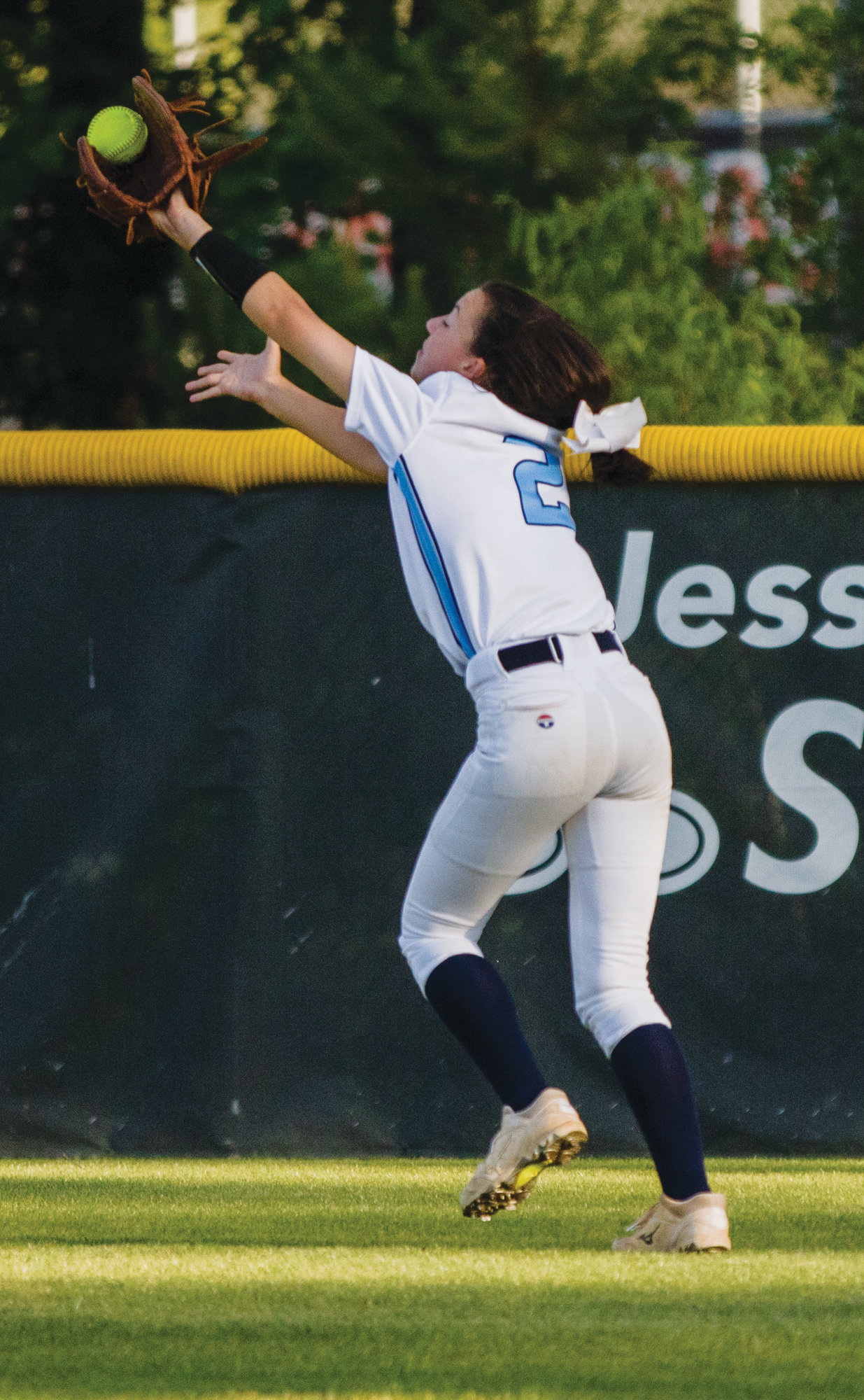 MICAH GREEN / THE SUMTER ITEM  Wilson Hall rightfielder Ansleigh Epps makes a catch in the Lady Barons' 7-0 loss to Cardinal Newman on Tuesday at the CN field in Columbia in Game 2 of the SCISA 3A state championship series.